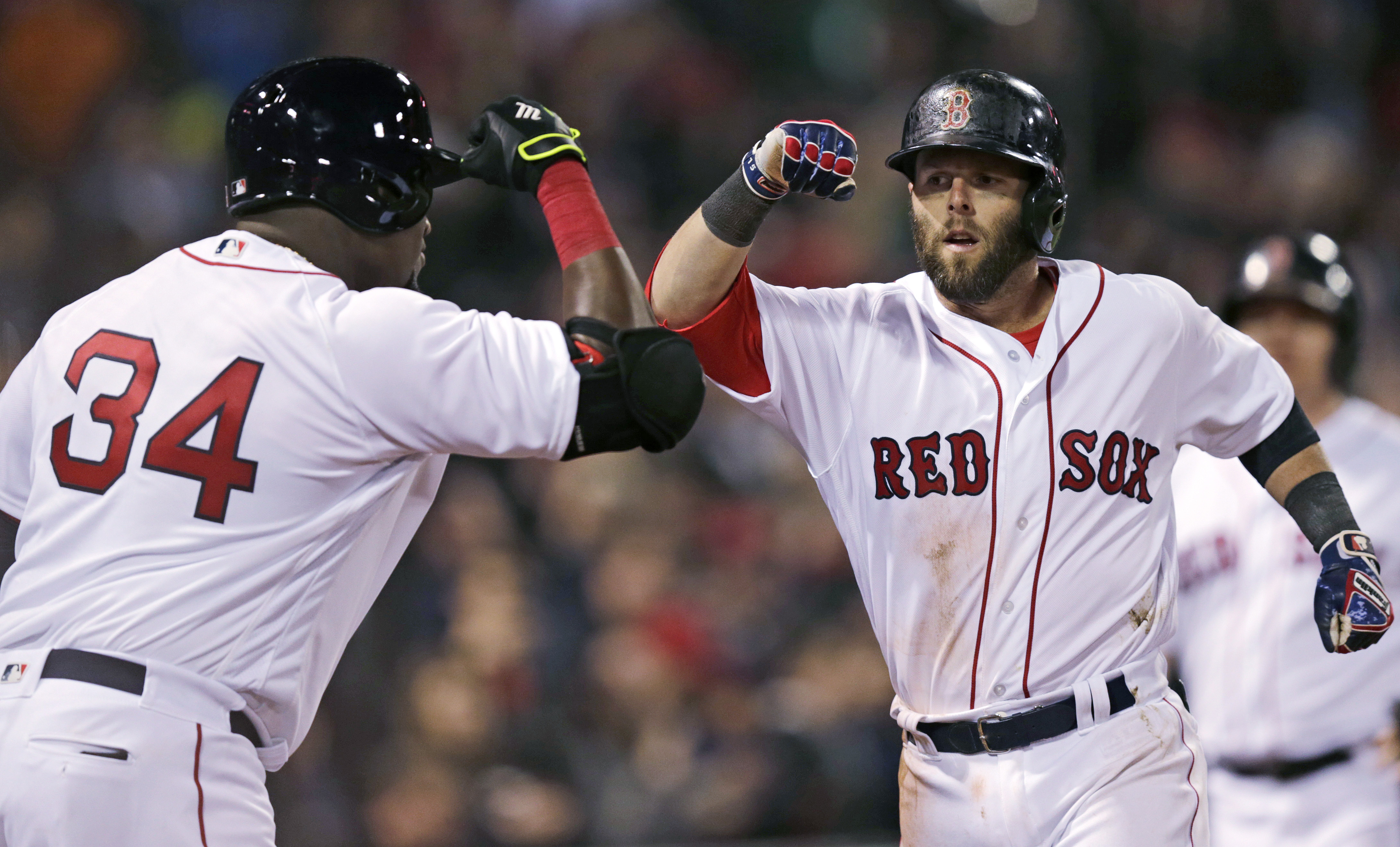 Boston Red Sox's Dustin Pedroia, right, is congratulated by David Ortiz (34) after his home run, his second of the night, during the eighth inning of a baseball game against the Atlanta Braves at Fenway Park in Boston, Wednesday, April 27, 2016. (AP Photo