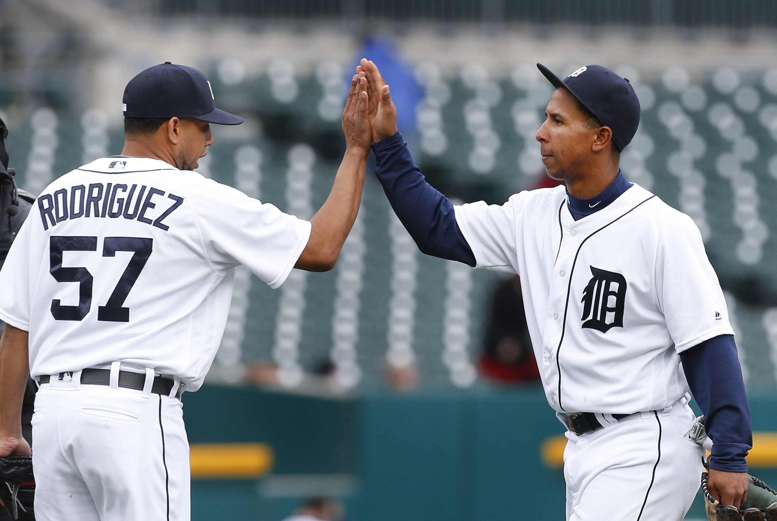 Detroit Tigers relief pitcher Francisco Rodriguez (57) congratulates Anthony Gose after beating the Oakland Athletics 7-3 in a baseball game in Detroit, Thursday, April 28, 2016. (AP Photo/Paul Sancya)
