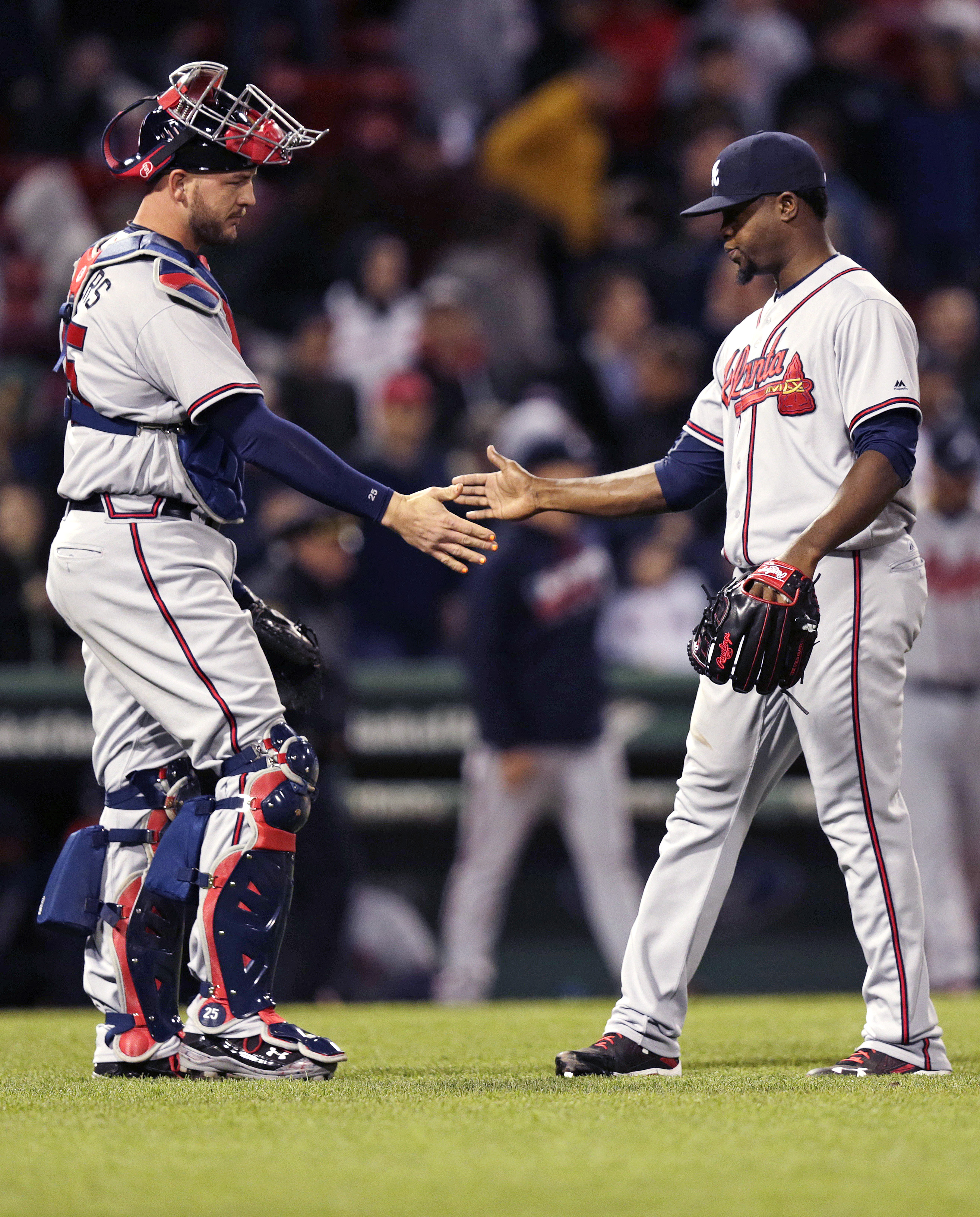 Atlanta Braves relief pitcher Arodys Vizcaino, right, is congratulated by catcher Tyler Flowers after earning a save during a baseball game against the Boston Red Sox at Fenway Park in Boston, Thursday, April 28, 2016. The Braves defeated the Red Sox 5-3.