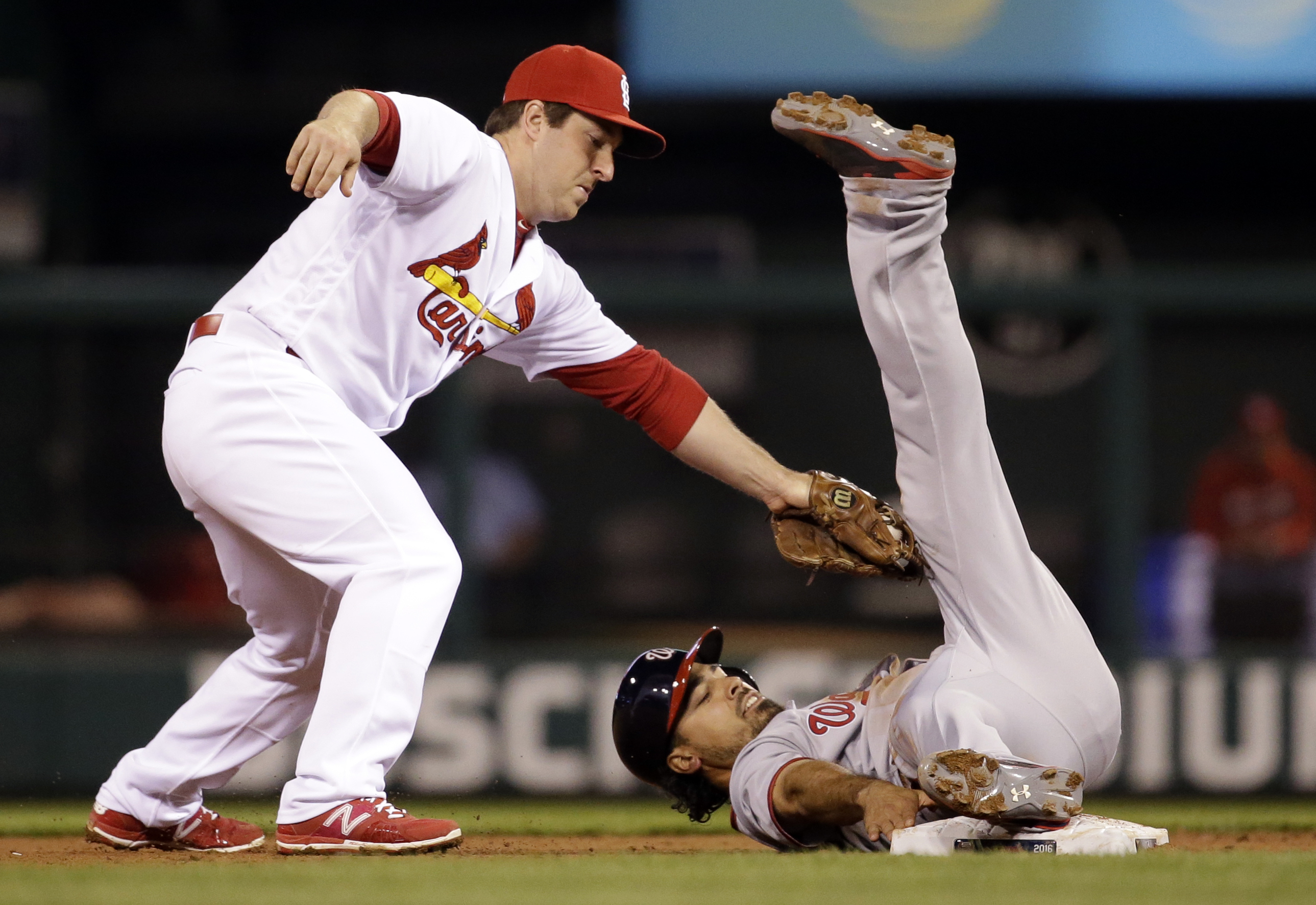Washington Nationals' Anthony Rendon, right, is tagged at second by St. Louis Cardinals shortstop Jedd Gyorko and ruled out during the fourth inning of a baseball game Friday, April 29, 2016, in St. Louis. The call was reversed after video review and Rend