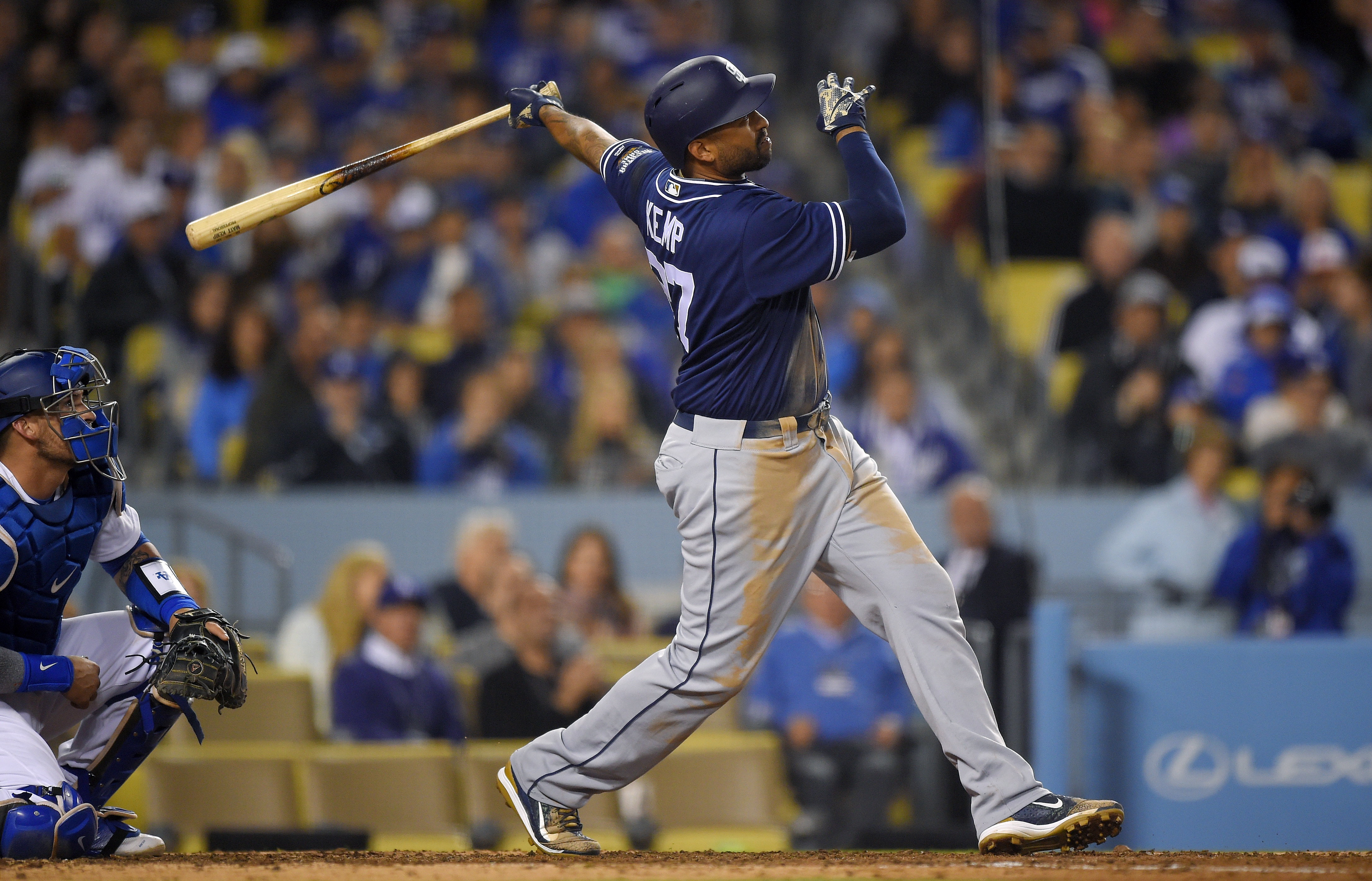 San Diego Padres' Matt Kemp watches his three-run home run, along with Los Angeles Dodgers catcher Yasmani Grandal, during the eighth inning of a baseball game Friday, April 29, 2016, in Los Angeles. (AP Photo/Mark J. Terrill)