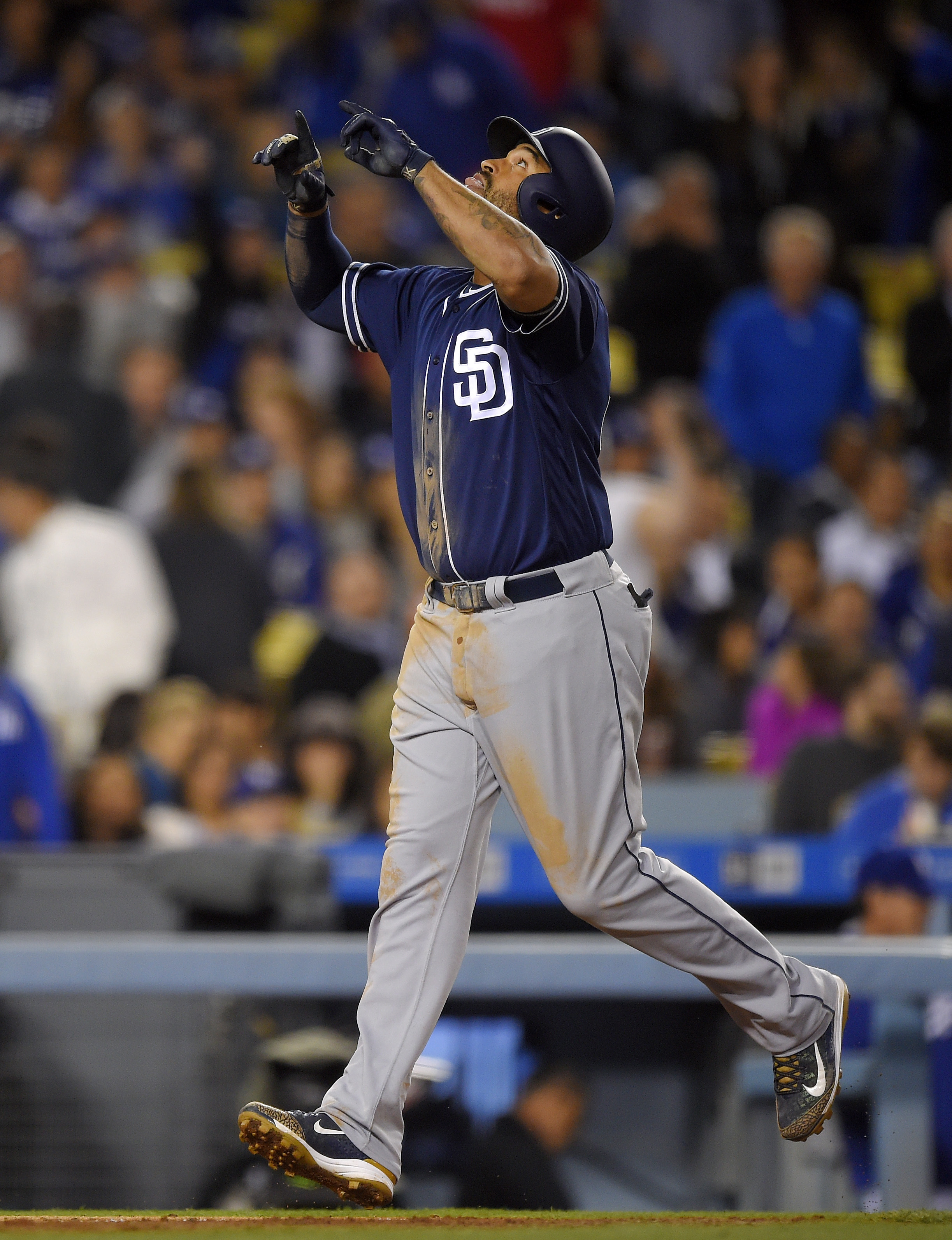 San Diego Padres' Matt Kemp points to the sky after hitting a three-run home run during the eighth inning of a baseball game against the Los Angeles Dodgers, Friday, April 29, 2016, in Los Angeles. (AP Photo/Mark J. Terrill)