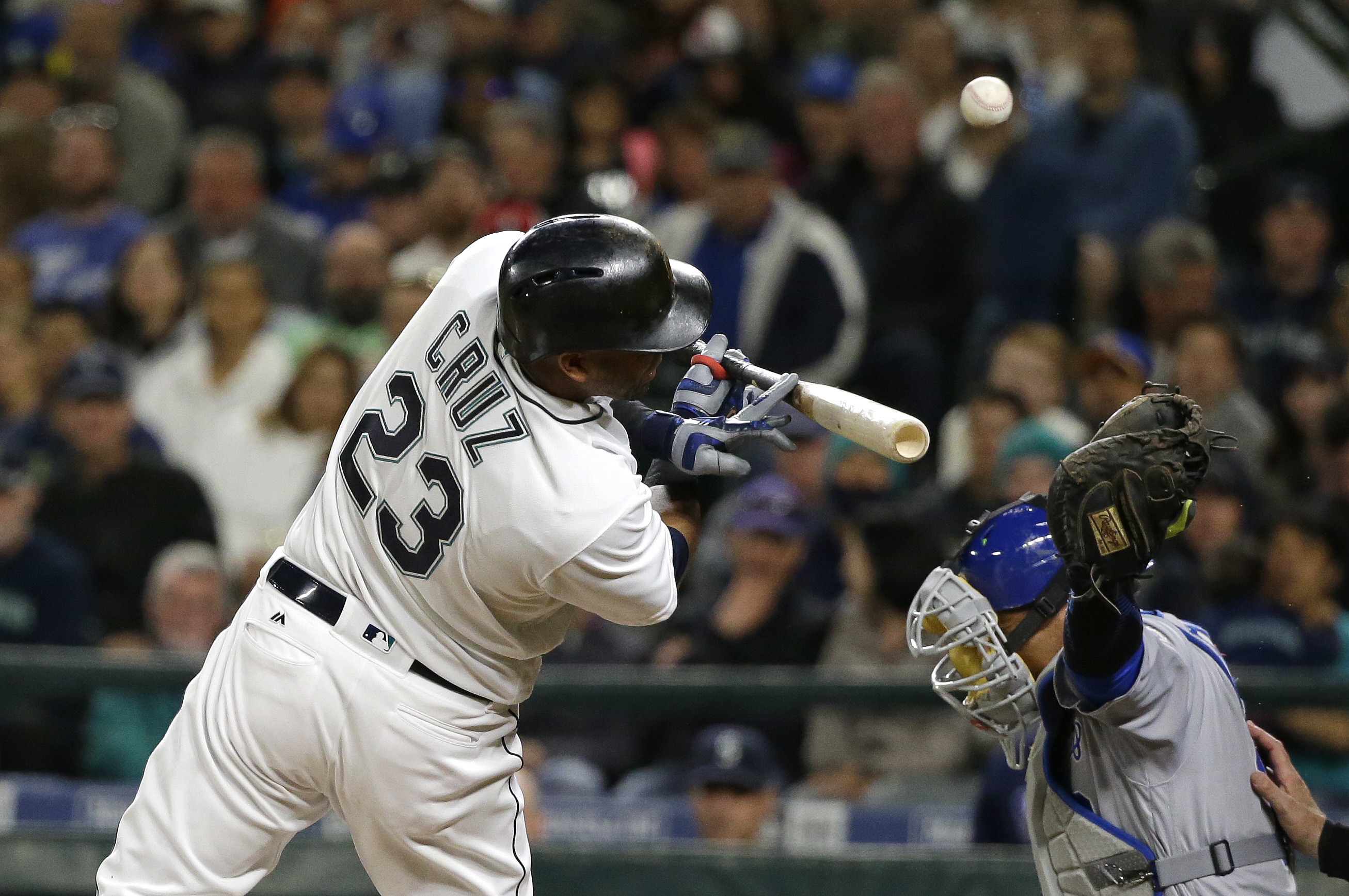 Seattle Mariners Nelson Cruz (23) is hit by a pitch thrown by Kansas City Royals' Dillon Gee during the sixth inning of a baseball game, Saturday, April 30, 2016, in Seattle. (AP Photo/Ted S. Warren)