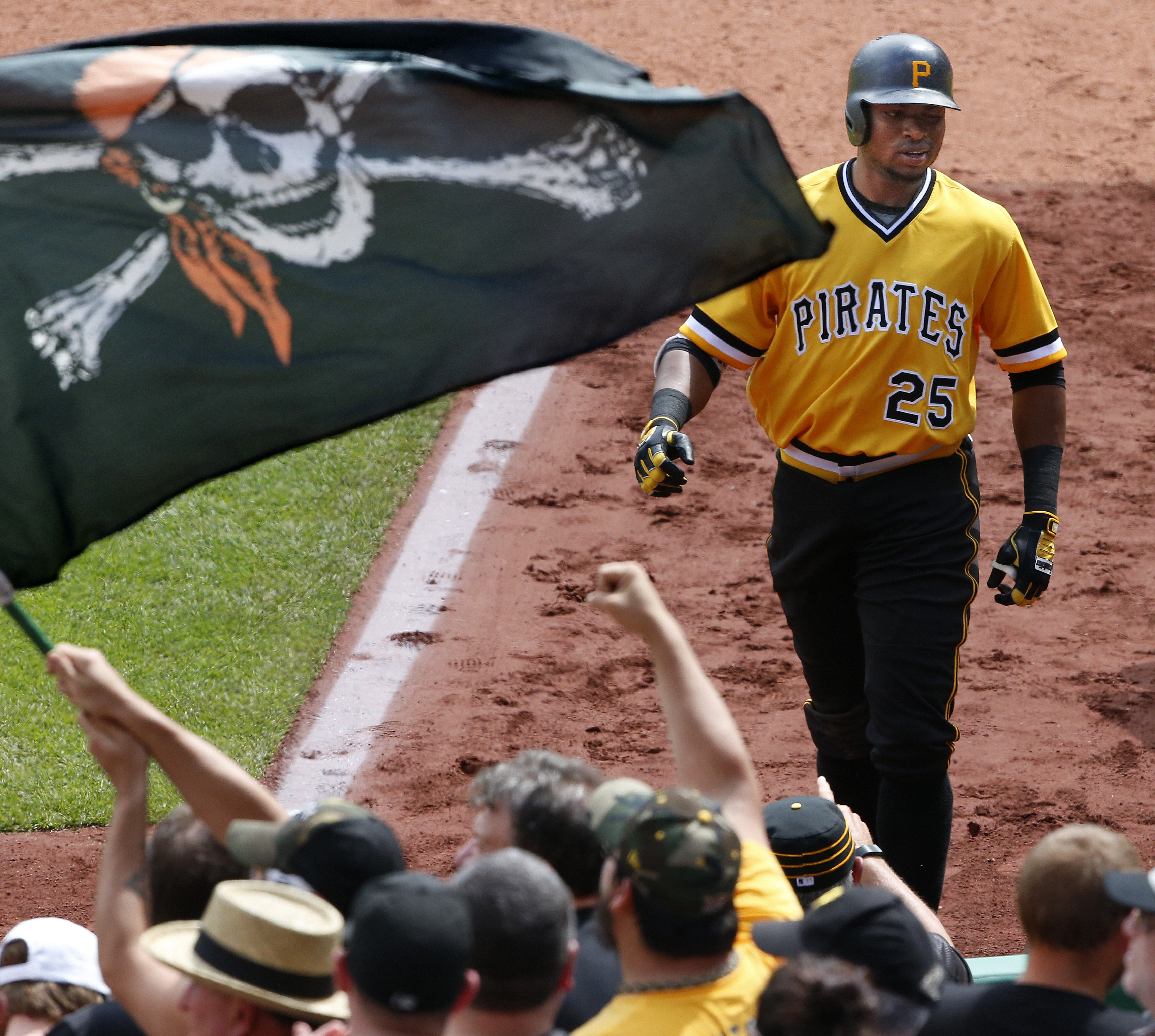 Pittsburgh Pirates' Gregory Polanco returns to the dugout after hitting a solo home run off Cincinnati Reds pitcher Tim Adleman during the fifth inning of a baseball game in Pittsburgh, Sunday, May 1, 2016. (AP Photo/Gene J. Puskar)