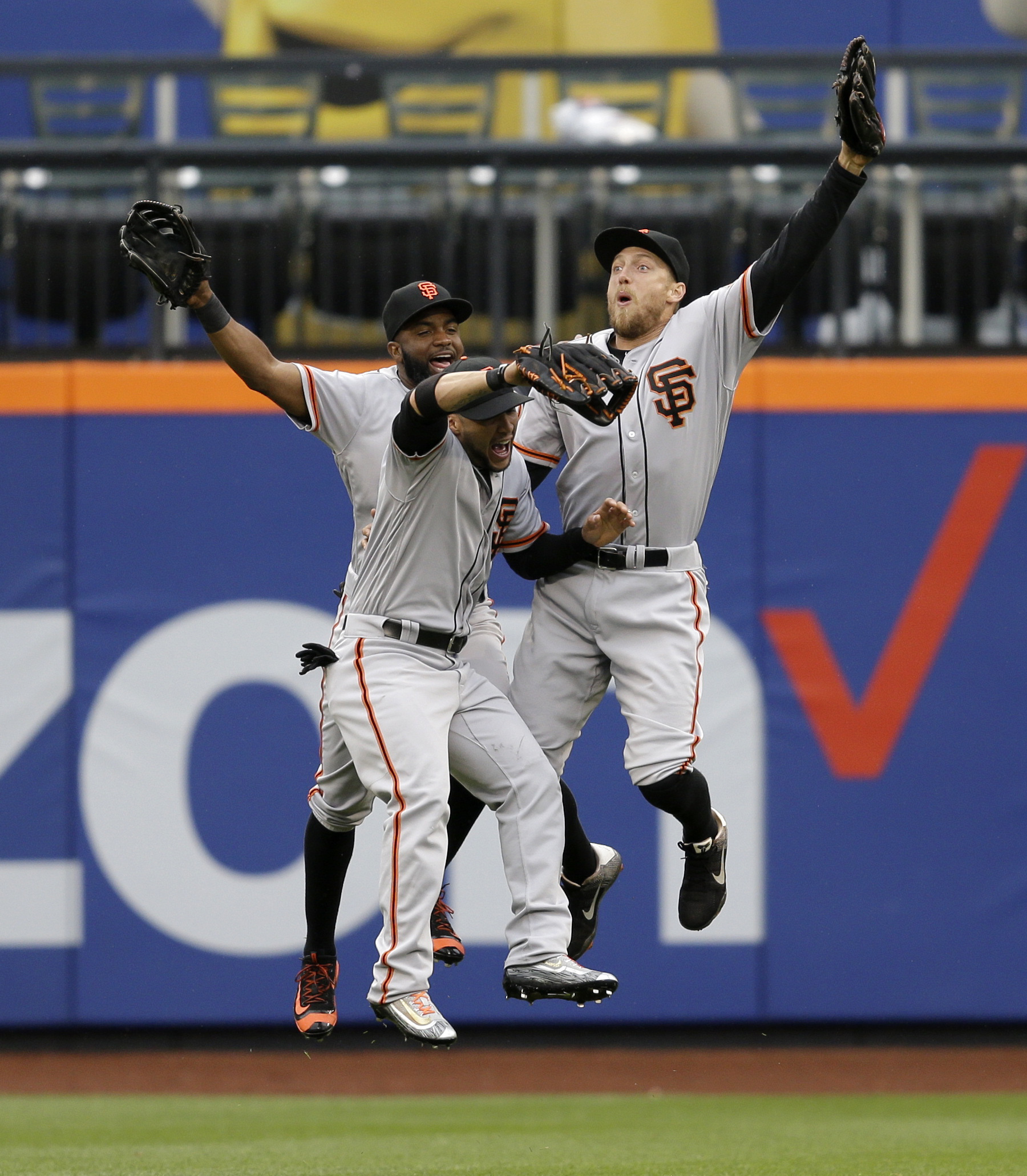 San Francisco Giants' outfielders Hunter Pence, right, Angel Pagan, center, and Denard Span celebrate after the baseball game against the New York Mets at Citi Field, Sunday, May 1, 2016 in New York. The Giants defeated the Mets 6-1. (AP Photo/Seth Wenig)
