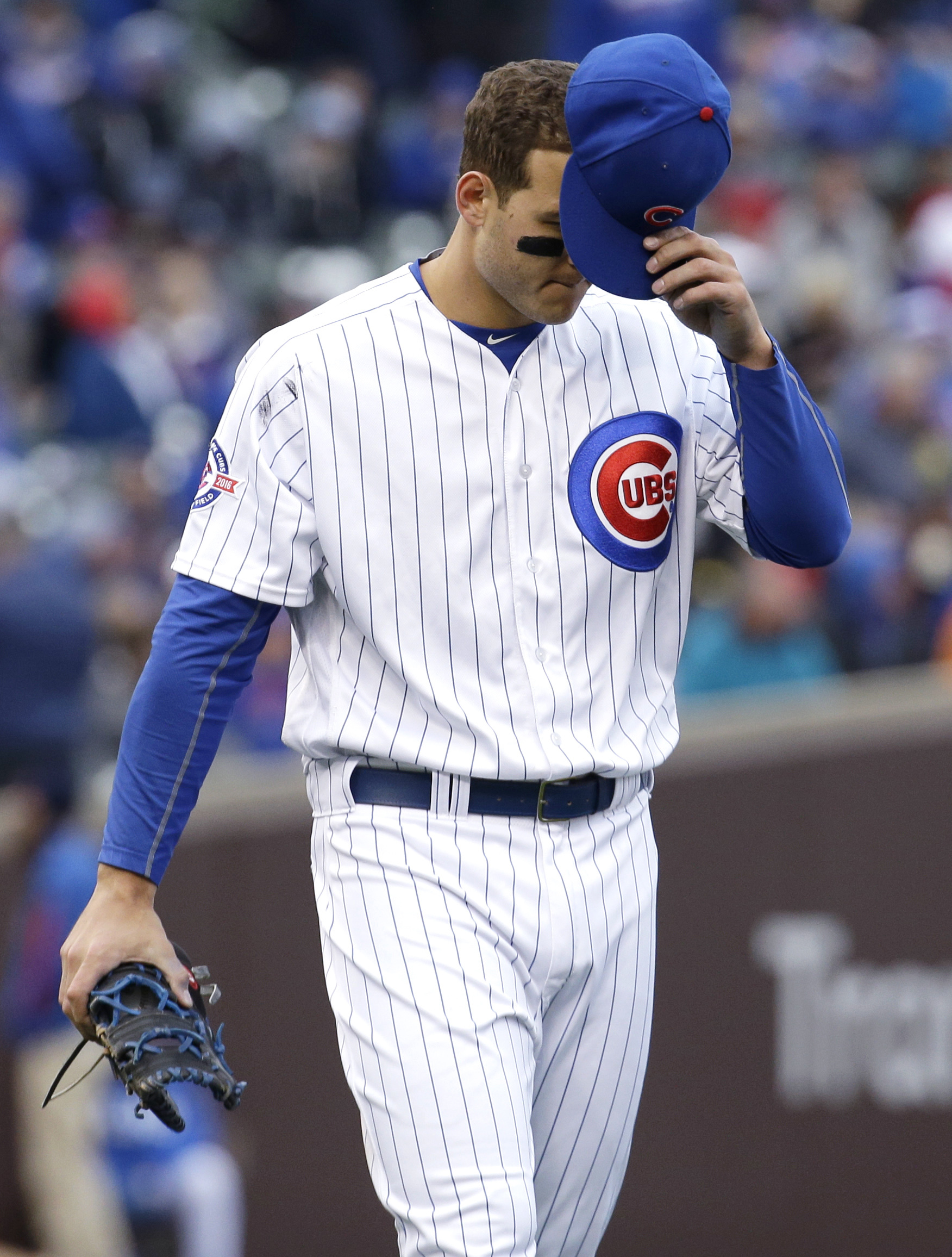 Chicago Cubs' Anthony Rizzo reacts as he walks to first base after striking out swinging during the eighth inning of a baseball game against the Atlanta Braves, Sunday, May 1, 2016, in Chicago. The Braves won 4-3. (AP Photo/Nam Y. Huh)