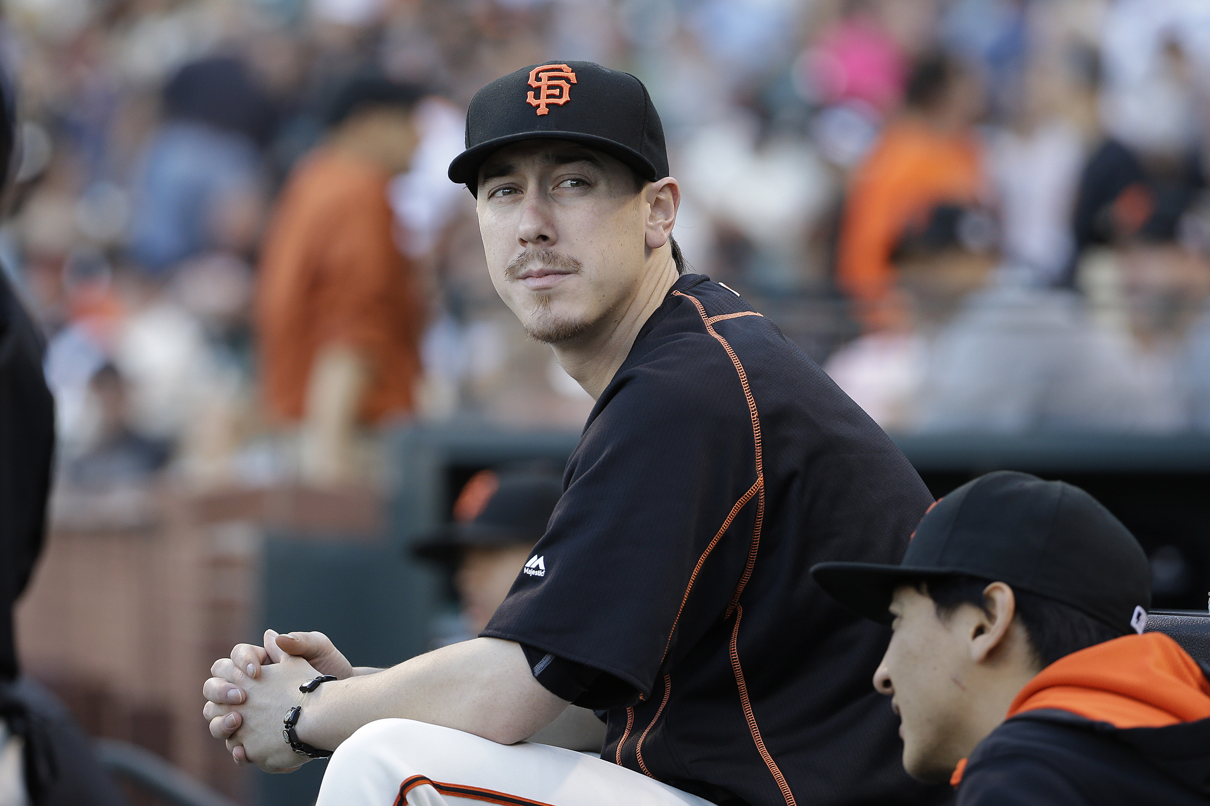 FILE - This July 28, 2015 file photo shows San Francisco Giants pitcher Tim Lincecum looking on during a baseball game against the Milwaukee Brewers in San Francisco. The two-time NL Cy Young Award winner will pitch for major league clubs in a showcase ev