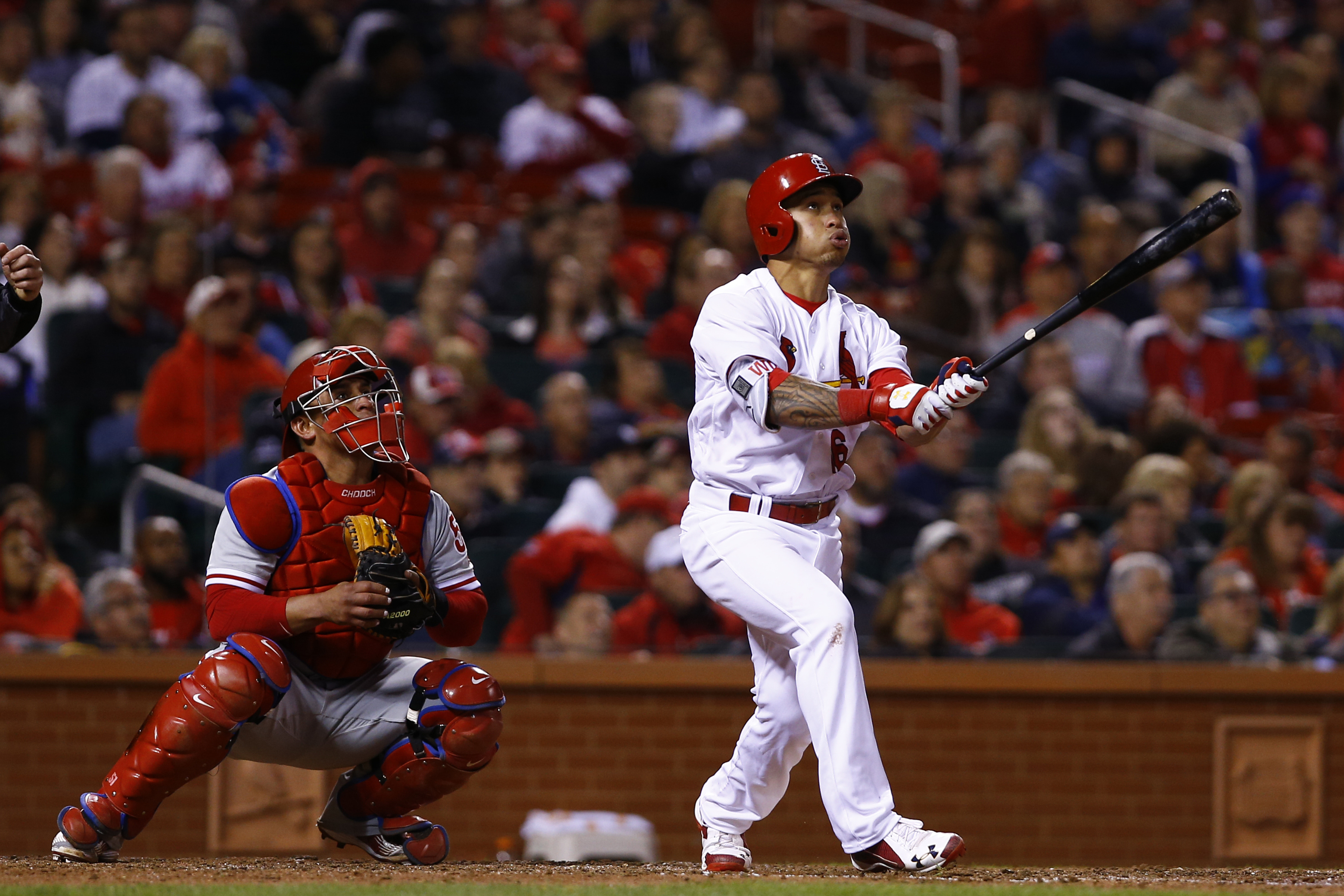 St. Louis Cardinals' Kolten Wong and Philadelphia Phillies catcher Carlos Ruiz watch Wongs home run during the seventh inning of a baseball game, Monday, May 2, 2016, in St. Louis. (AP Photo/Billy Hurst)