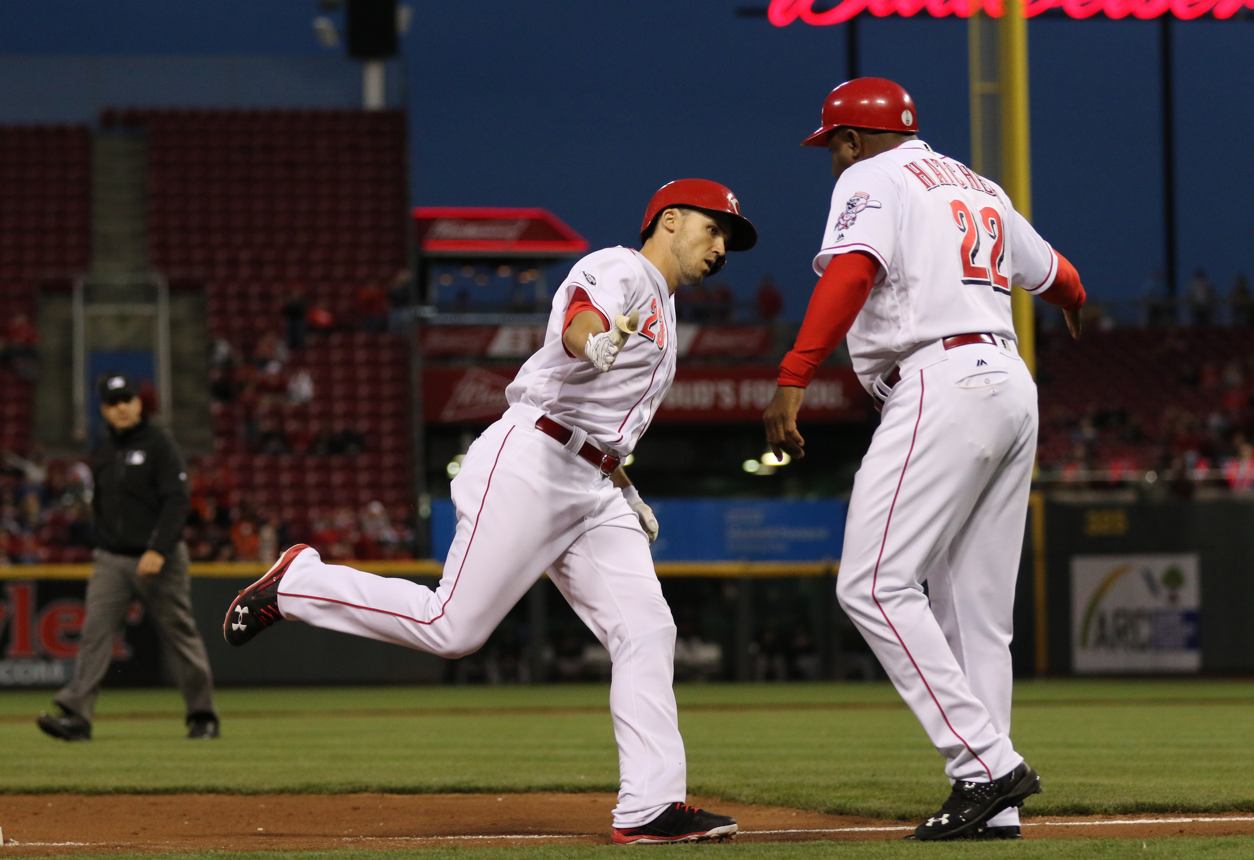 Cincinnati Reds Adam Duvall, left, is congratulated by third base coach Billy Hatcher (22) as he rounds the bases with a home run off San Francisco Giants starting pitcher Jeff Samardzija during the fifth inning of a baseball game, Tuesday, May 3, 2016, i