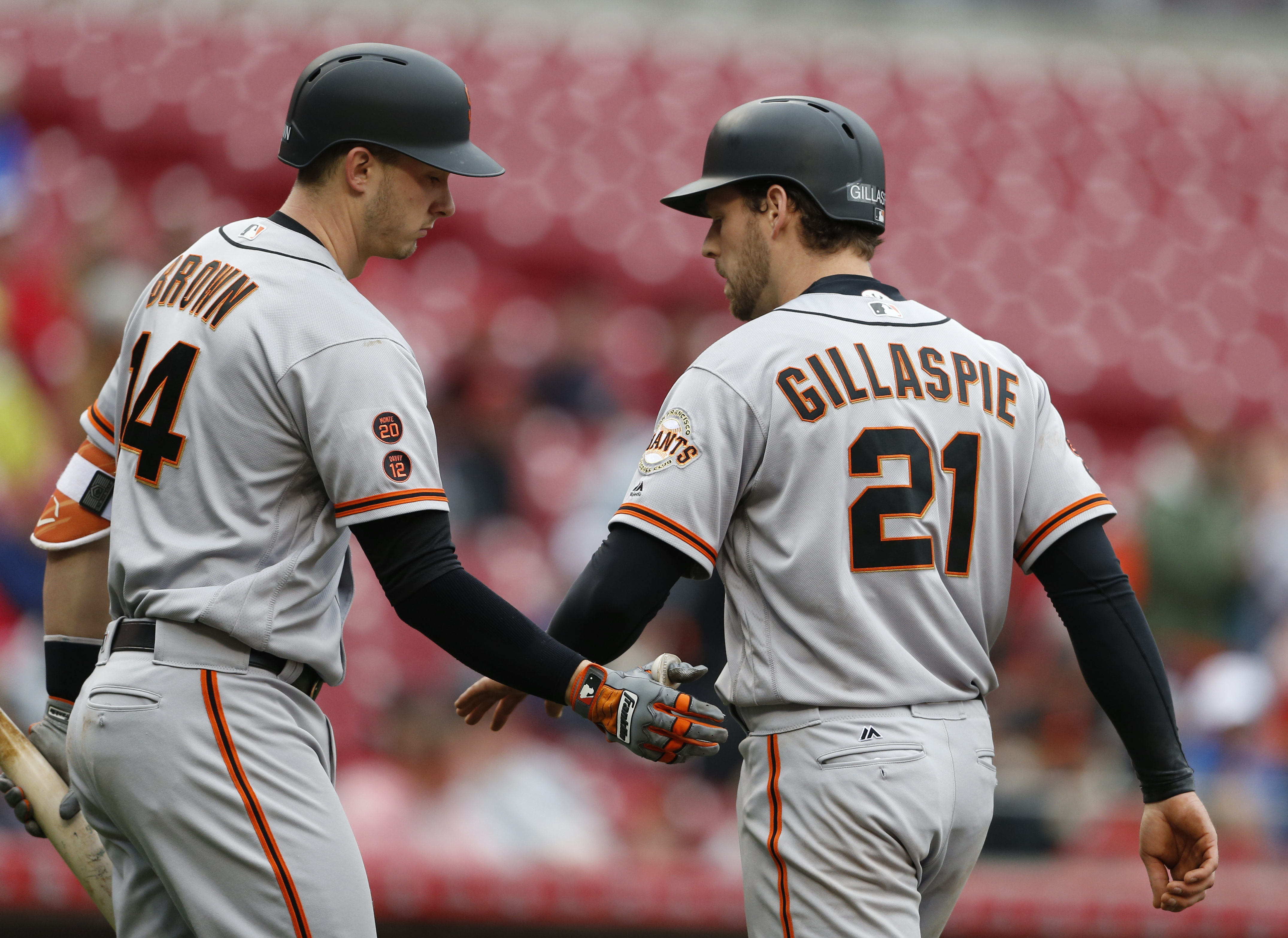 San Francisco Giants' Conor Gillaspie (21) is congratulated by Trevor Brown (14) after hitting a solo home run off Cincinnati Reds pitcher Dan Straily during the fourth inning of a baseball game, Wednesday, May 4, 2016, in Cincinnati. (AP Photo/Gary Lande