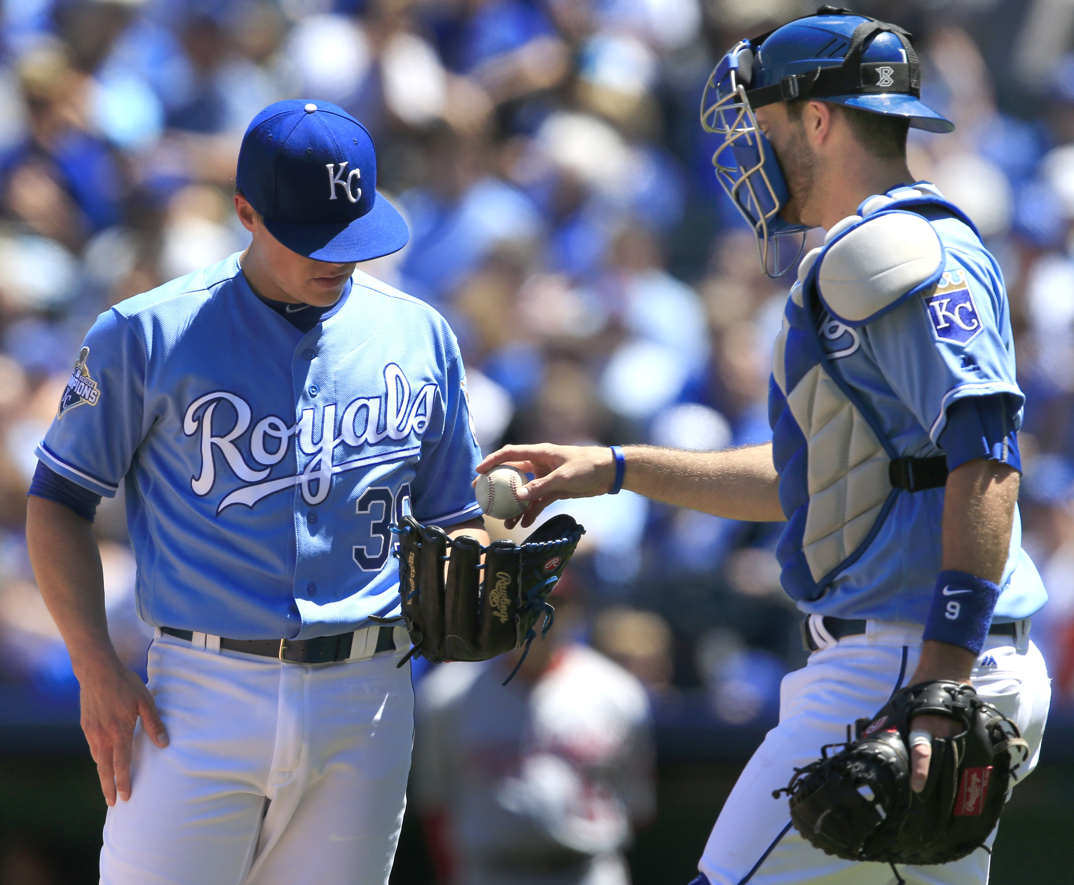Kansas City Royals catcher Drew Butera, right, hands the ball to starting pitcher Kris Medlen (39) during the first inning of a baseball game against the Washington Nationals at Kauffman Stadium in Kansas City, Mo., Wednesday, May 4, 2016. The Royals comm