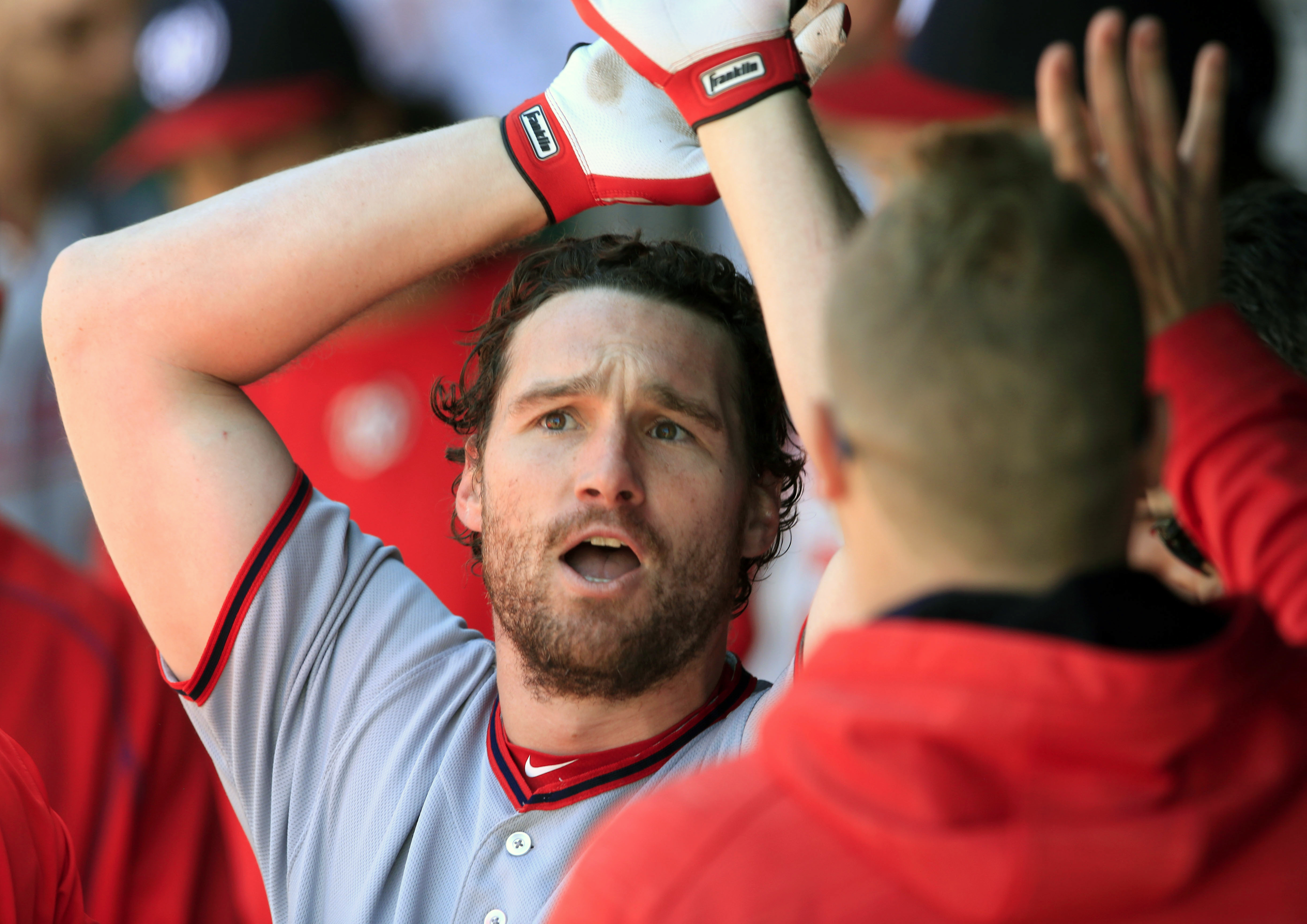Washington Nationals' Daniel Murphy is congratulated by teammates after his solo home run during the fourth inning of a baseball game against the Kansas City Royals at Kauffman Stadium in Kansas City, Mo., Wednesday, May 4, 2016. (AP Photo/Orlin Wagner)