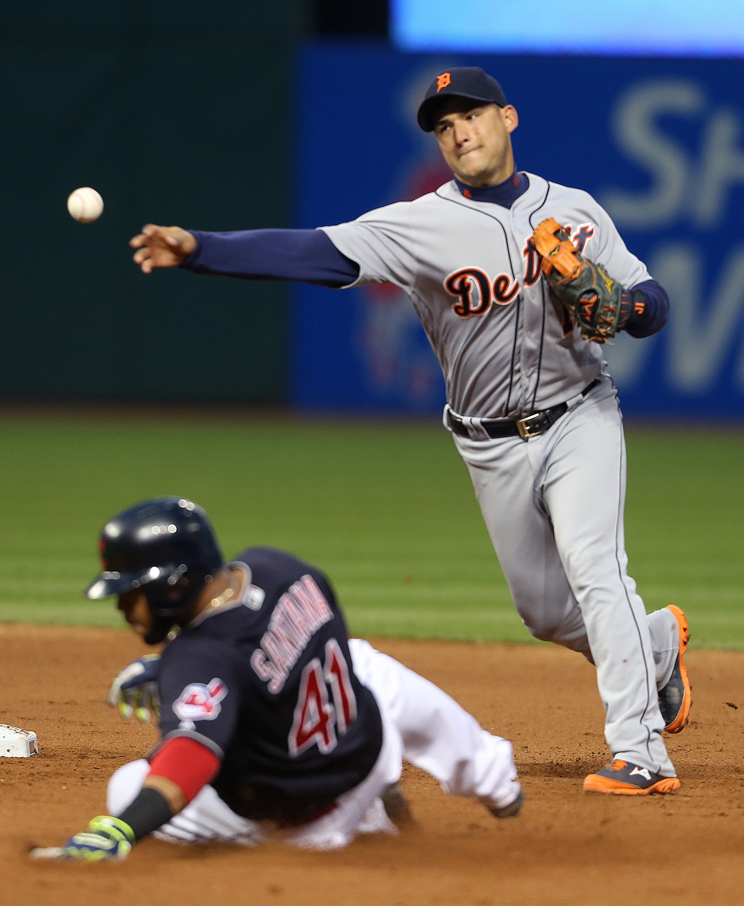 Detroit Tigers' Jose Iglesias (1) turns a double play over Cleveland Indians' Carlos Santana (41) and throws out Jason Kipnis at first base during the eighth inning of a baseball game, Wednesday, May 4, 2016, in Cleveland. The Indians won 4-0. (AP Photo/R