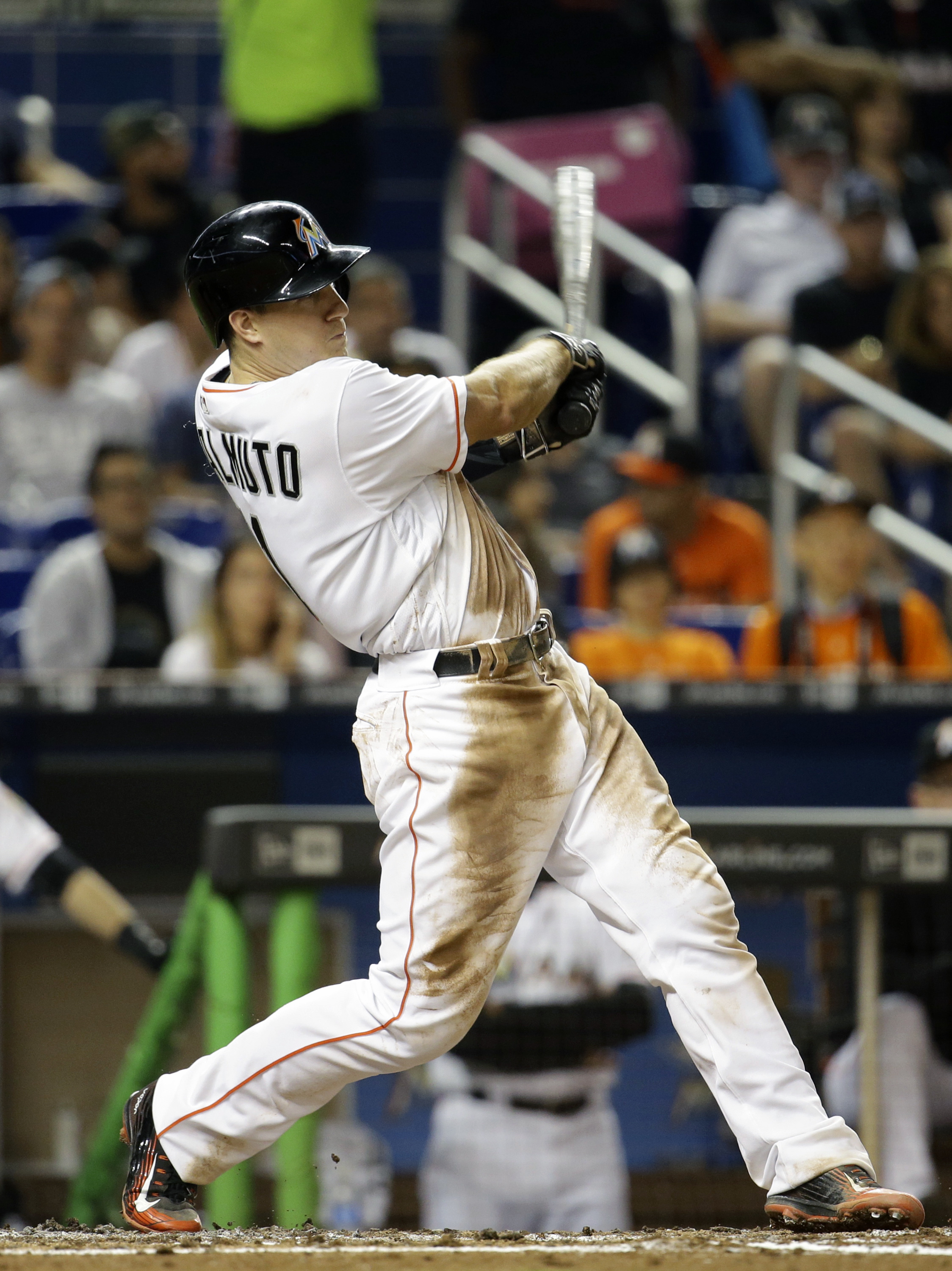 Miami Marlins' J.T. Realmuto follows through on a double during the third inning of a baseball game against the Arizona Diamondbacks, Wednesday, May 4, 2016, in Miami. (AP Photo/Lynne Sladky)