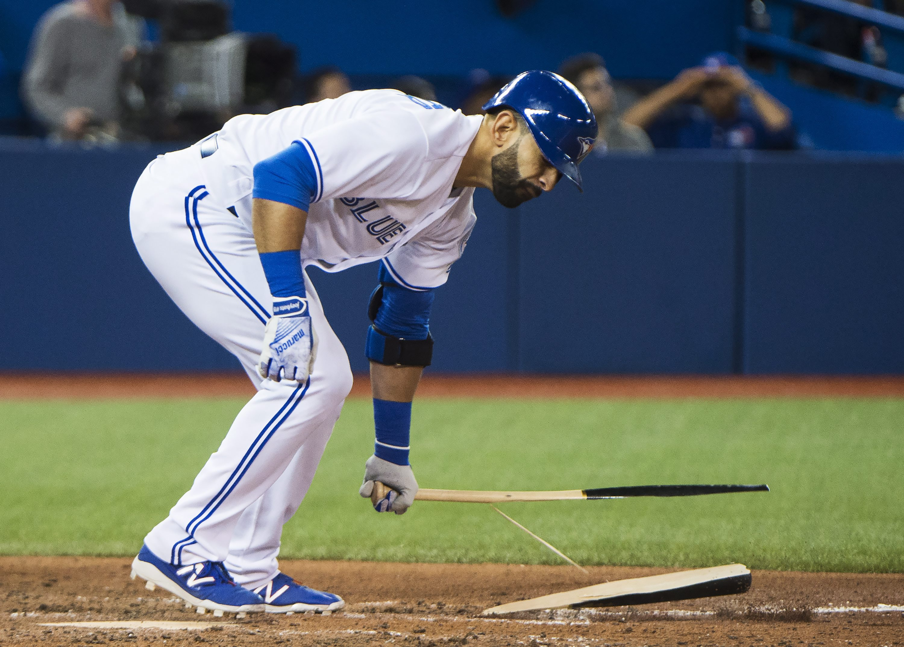 Toronto Blue Jays right fielder Jose Bautista (19) breaks his bat in frustration after hitting a pop fly out during the eighth inning of a baseball game against the Texas Rangers, Wednesday, May 4, 2016, 2016 in Toronto. (Nathan Denette/The Canadian Press