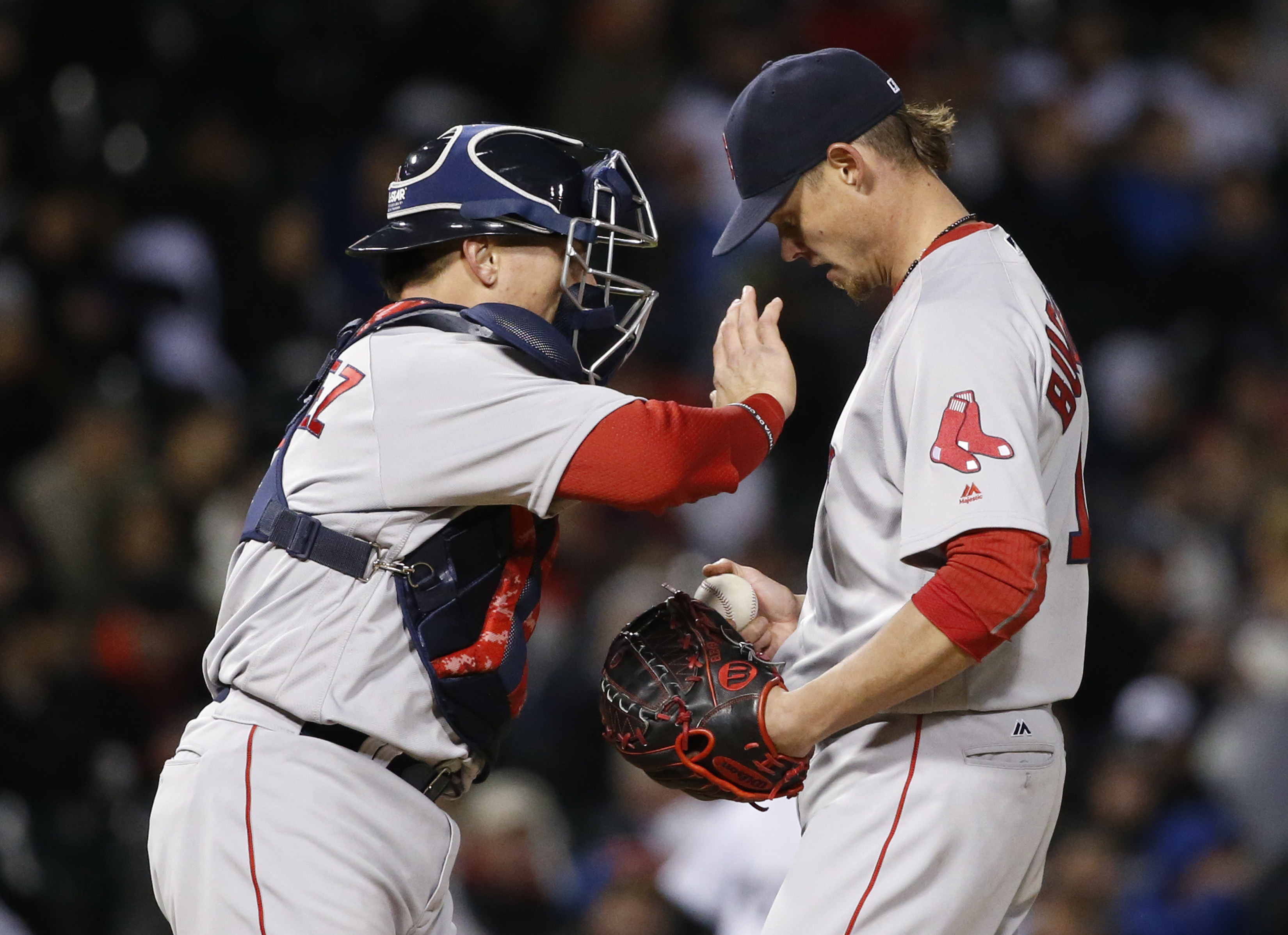 Boston Red Sox catcher Christian Vazquez, left, encourages starting pitcher Clay Buchholz during the fourth inning of a baseball game against the Chicago White Sox Wednesday, May 4, 2016, in Chicago. (AP Photo/Charles Rex Arbogast)