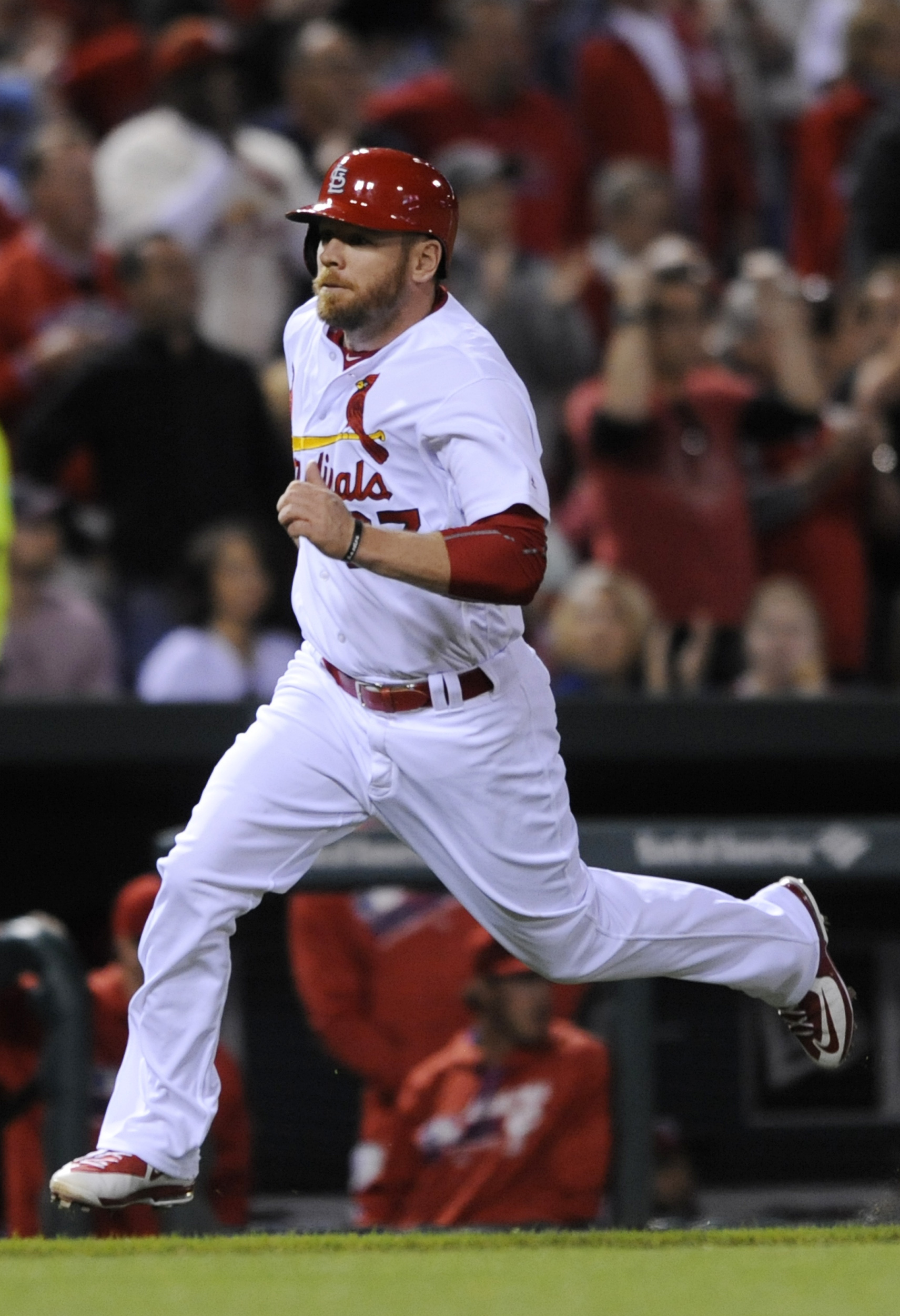 St. Louis Cardinals' Brandon Moss (37) runs home on an RBI single by Stephen Piscotty against the Philadelphia Phillies in the fifth inning of a baseball game, Wednesday, May 4, 2016, at Busch Stadium in St. Louis. (AP Photo/Bill Boyce)