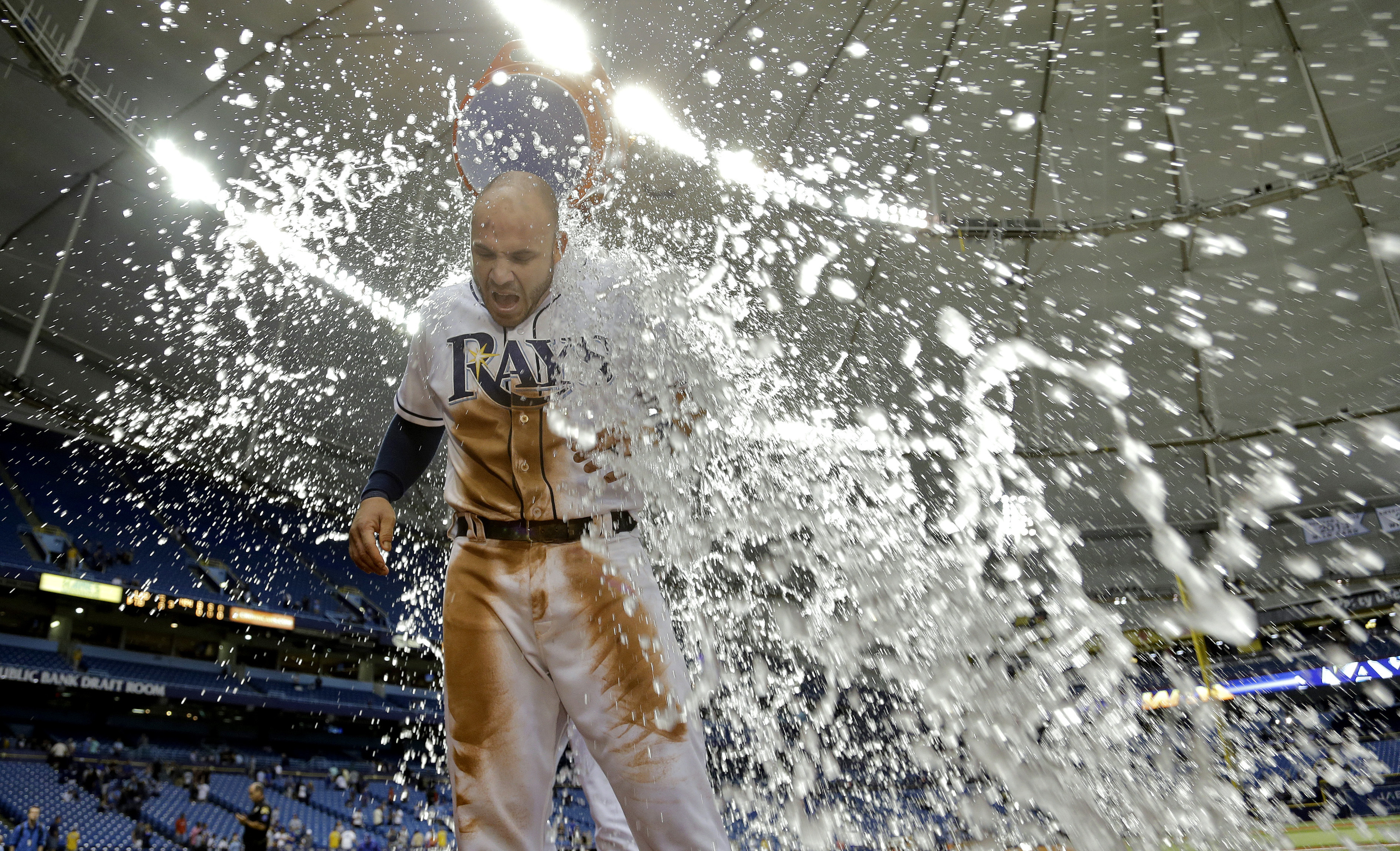 Tampa Bay Rays' Steve Pearce gets doused with ice water from starting pitcher Chris Archer after the Rays defeated the Los Angeles Dodgers 8-5 during an interleague baseball game Wednesday, May 4, 2016, in St. Petersburg, Fla. (AP Photo/Chris O'Meara)
