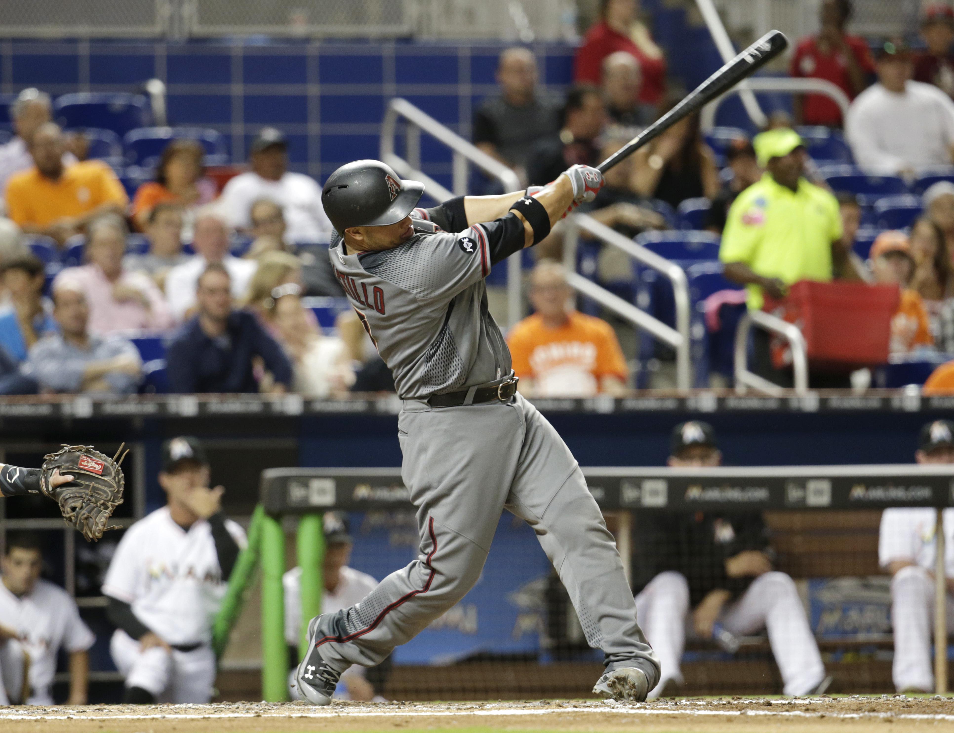 Arizona Diamondbacks' Welington Castillo hits a single during the fourth inning of a baseball game against the Miami Marlins, Thursday, May 5, 2016, in Miami. (AP Photo/Lynne Sladky)
