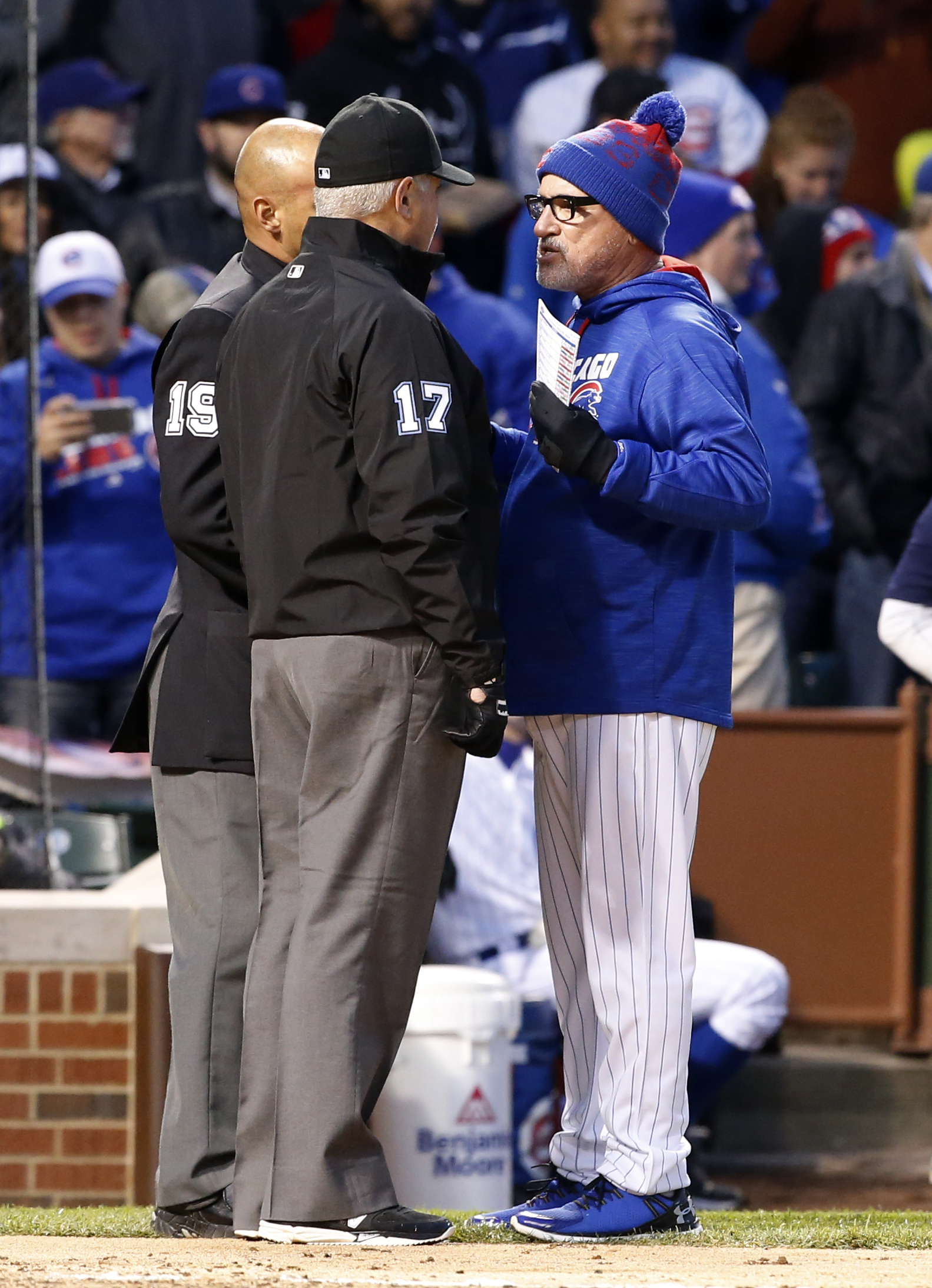 Chicago Cubs manager Joe Maddon, right, argues with home plate umpire Vic Carapazza and first base umpire John Hirschbeck after Dexter Fowler ejected by home plate umpire Vic Carapazza after the third inning of a baseball game against the Washington Natio