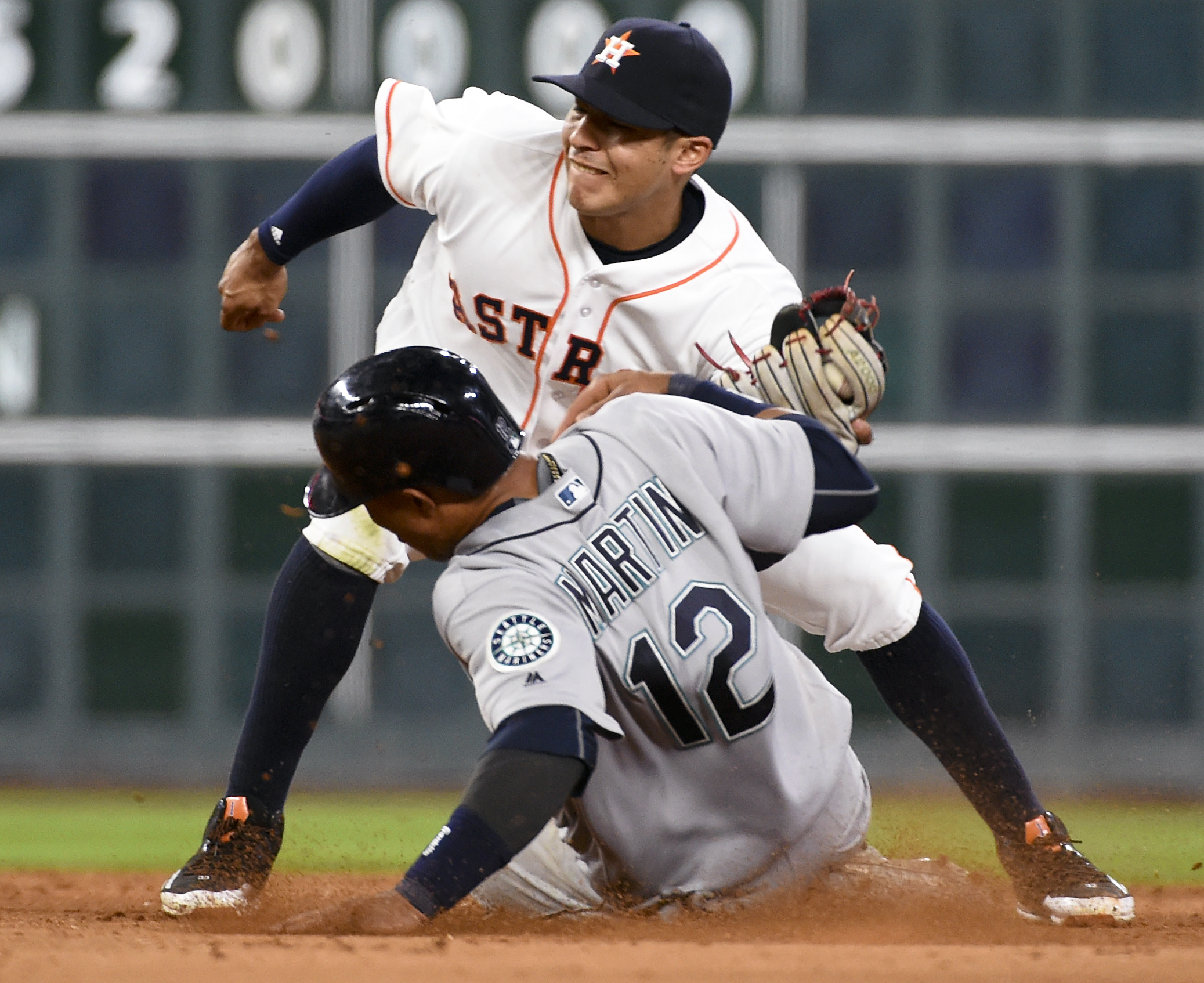 Seattle Mariners' Leonys Martin beats the tag of Houston Astros shortstop Carlos Correa while stealing second in the fifth inning of a baseball game, Thursday, May 5, 2016, in Houston. (AP Photo/Eric Christian Smith)