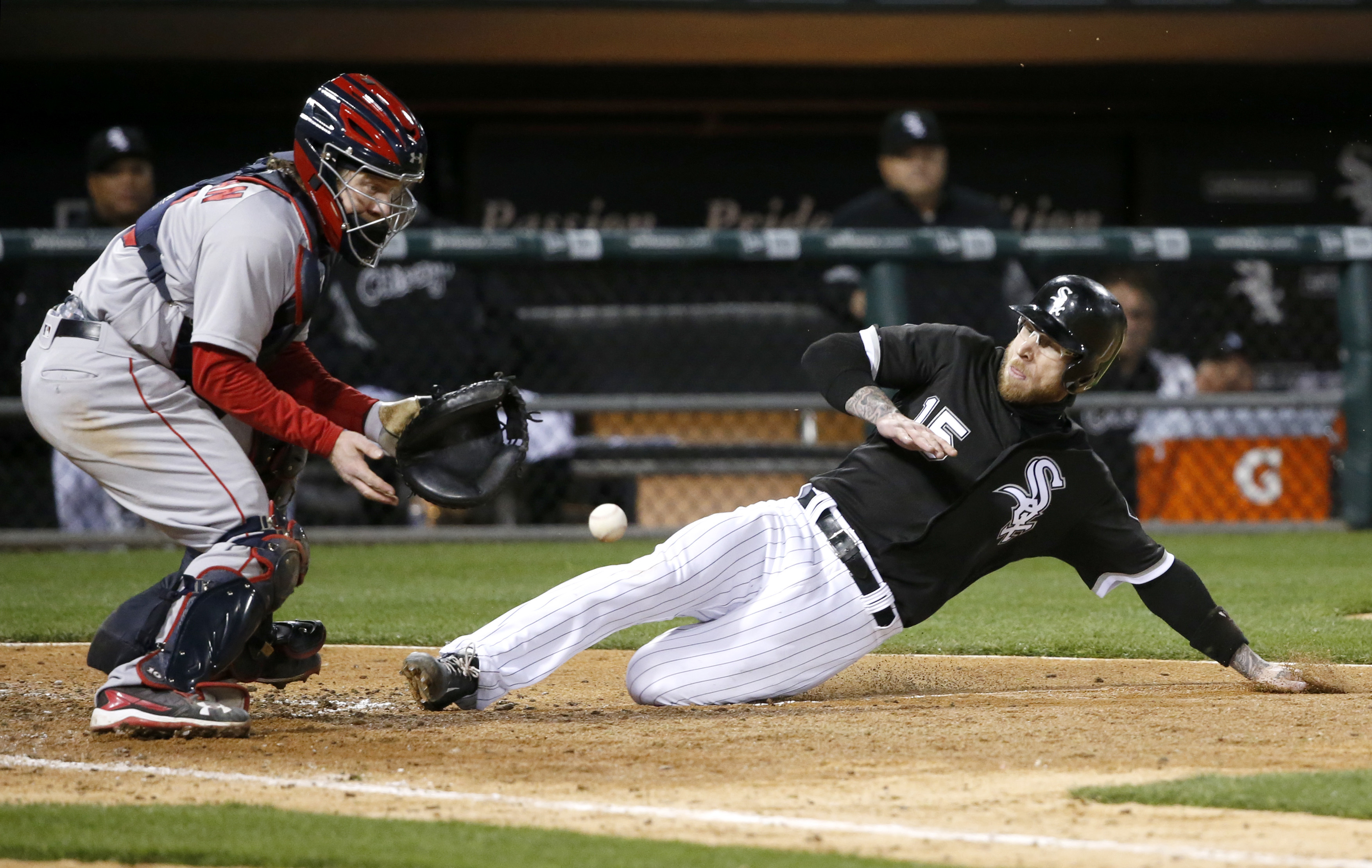 Chicago White Sox's Brett Lawrie, right, tries to score on a sacrifice fly by Austin Jackson but is called out on a throw from Boston Red Sox right fielder Mookie Betts to catcher Ryan Hanigan during the fifth inning of a baseball game Thursday, May 5, 20