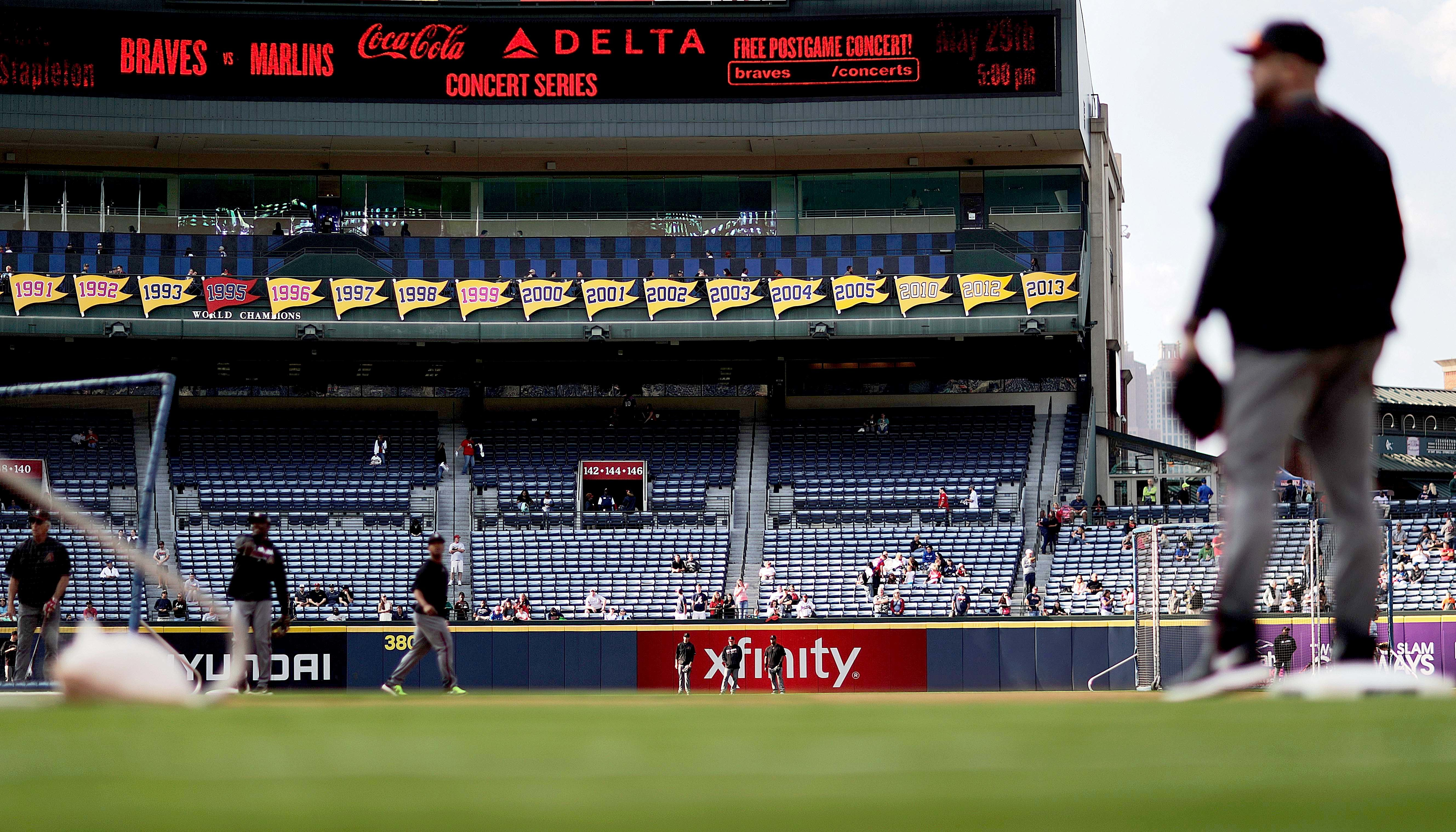 Banners hang in the outfield of Turner Field before the start of a baseball game between the Atlanta Braves and the Arizona Diamondbacks, Friday, May 6, 2016, in Atlanta. Banners line the left-field facade, an in-your-face reminder of what the Braves once