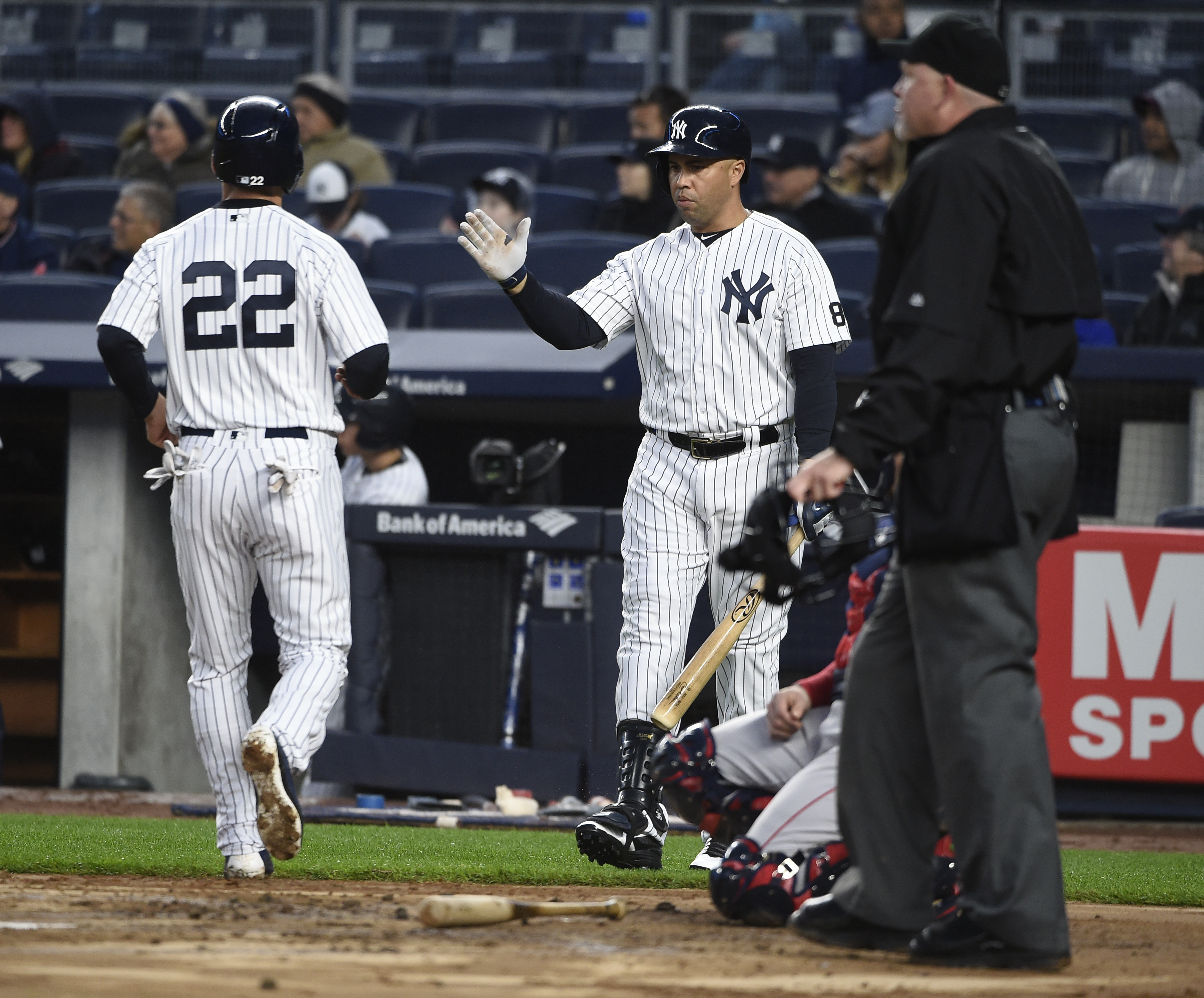 New York Yankees Carlos Beltran greets Jacoby Ellsbury (22) at home plate after Ellsbury scored on Brian McCann's single off of Boston Red Sox starting pitcher Rick Porcello in the first inning of a baseball game, Friday, May 6, 2016, in New York. (AP Pho