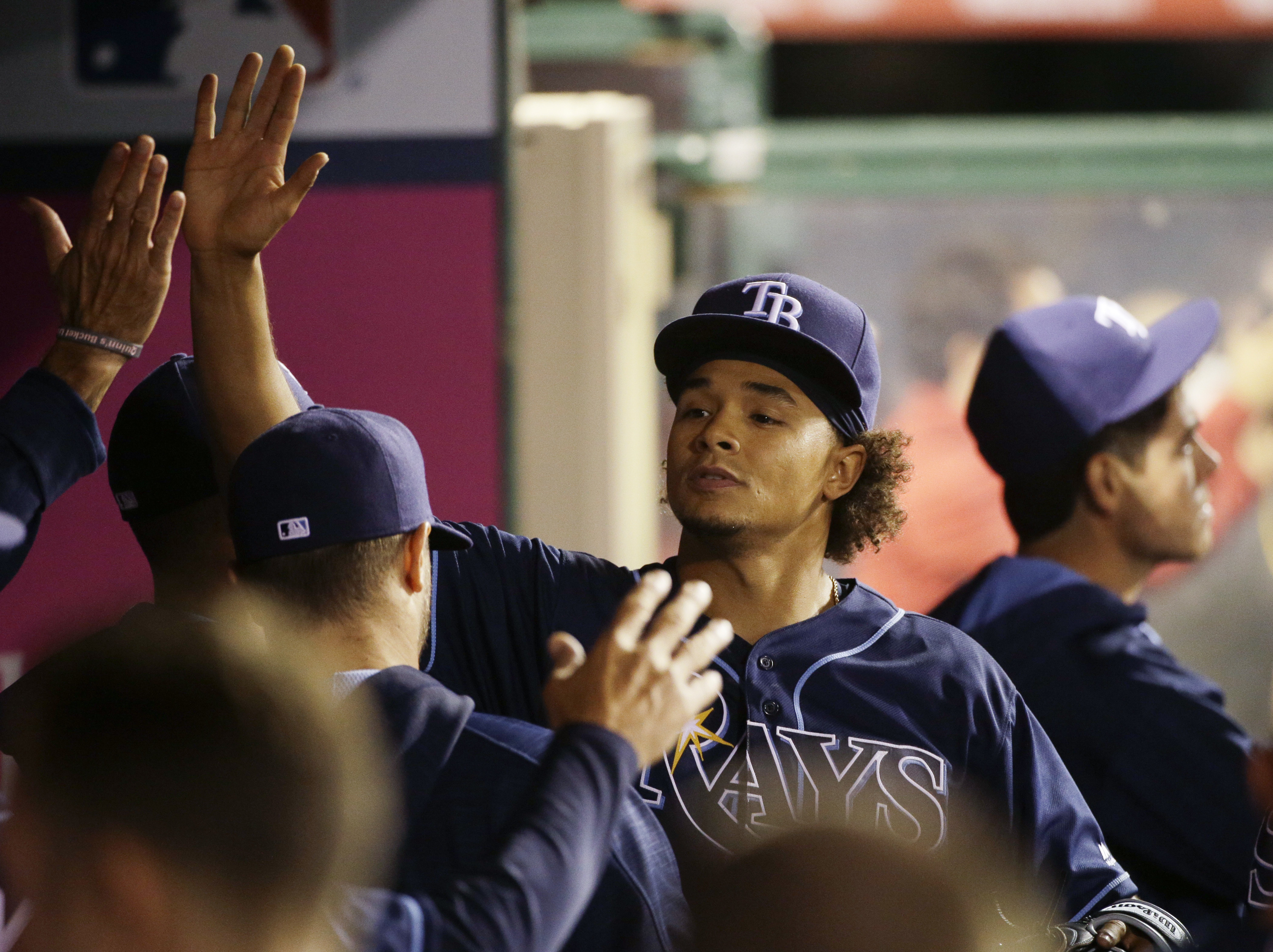 Tampa Bay Rays starting pitcher Chris Archer is greeted by teammates in the dugout after the bottom of the sixth inning of a baseball game, Friday, May 6, 2016, in Anaheim, Calif. (AP Photo/Jae C. Hong)