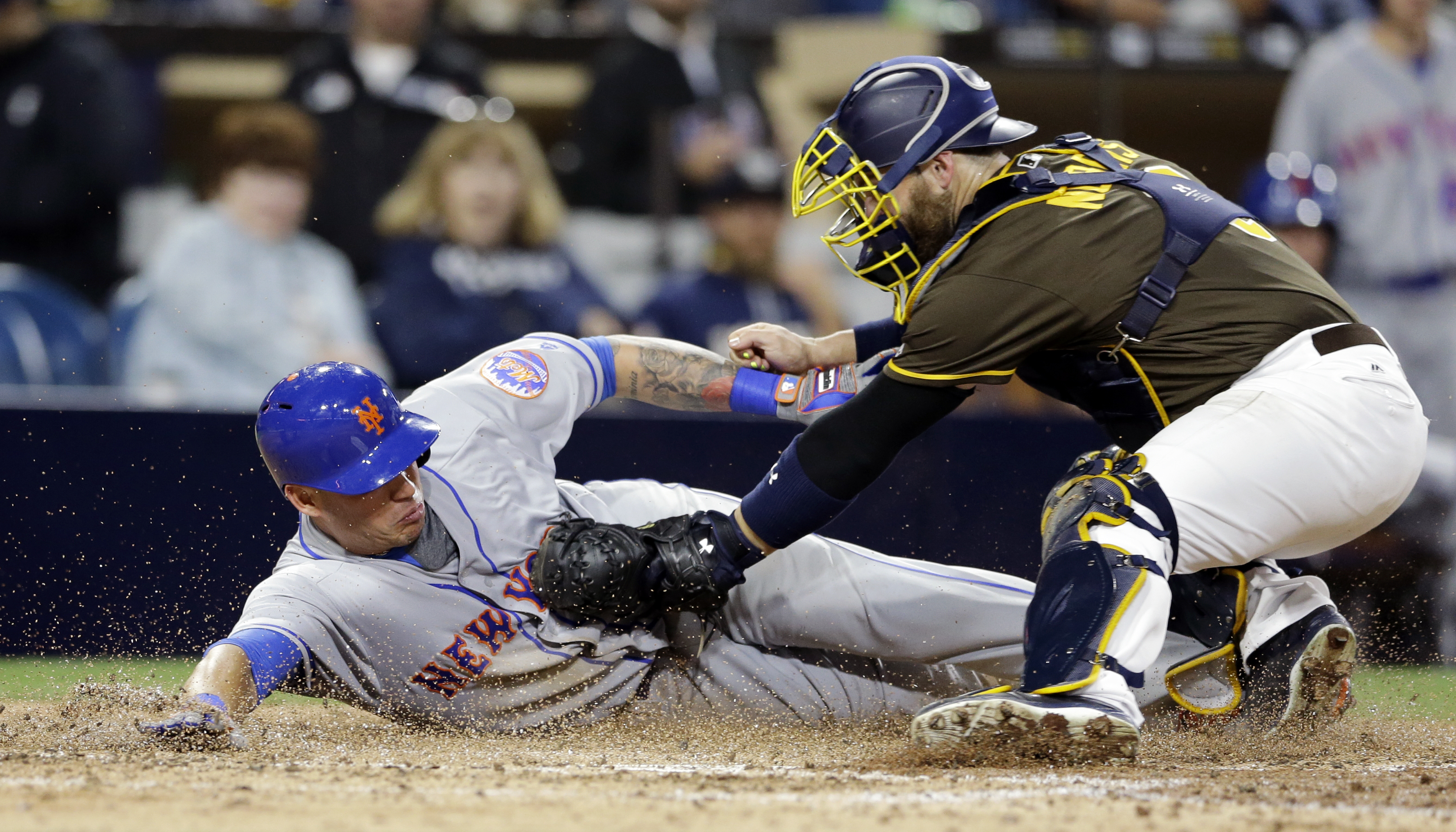 San Diego Padres catcher Derek Norris, right, tags out New York Mets' Asdrubal Cabrera during the seventh inning of a baseball game Friday, May 6, 2016, in San Diego. (AP Photo/Gregory Bull)