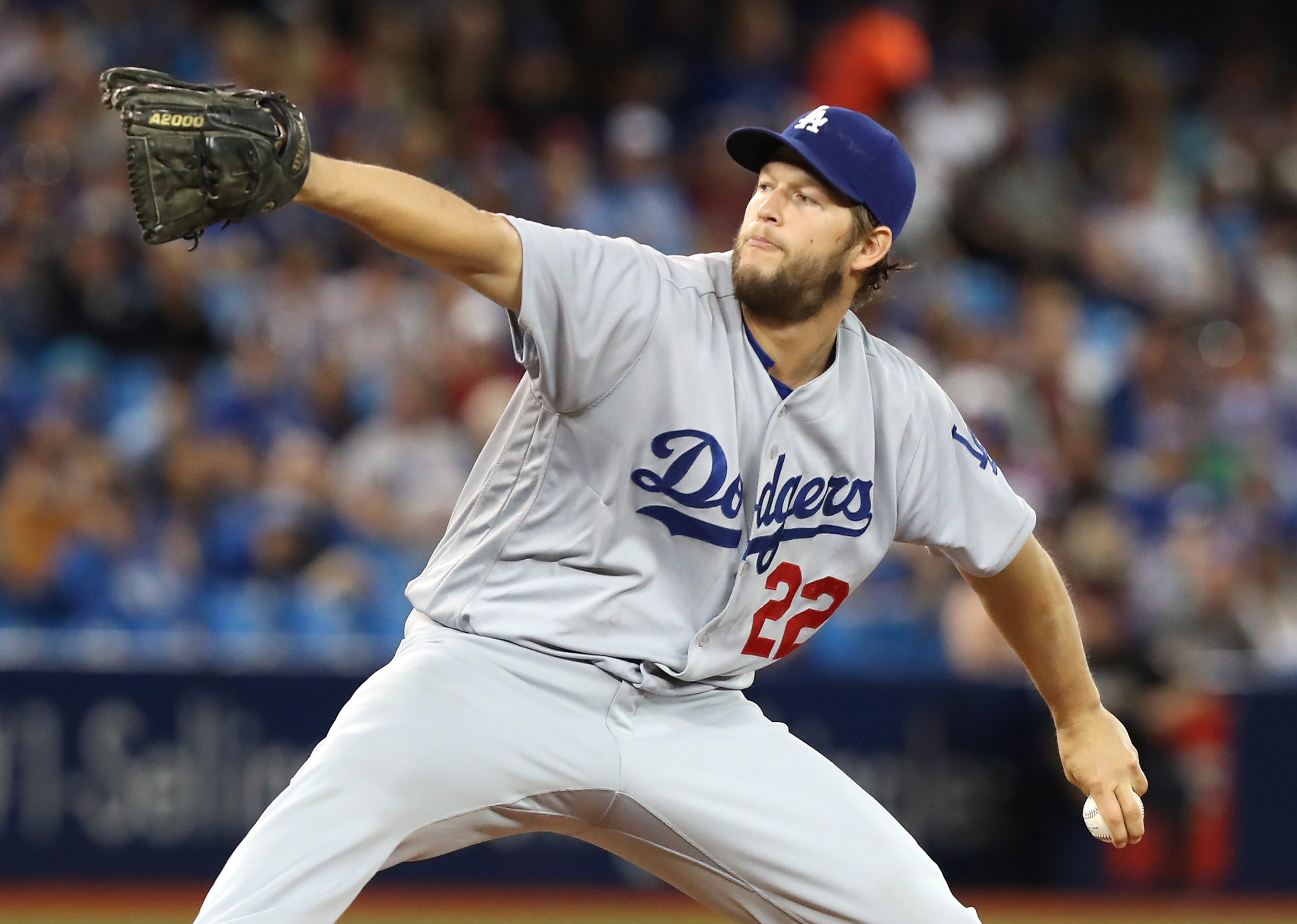 Los Angeles Dodgers starting pitcher Clayton Kershaw throws against the Toronto Blue Jays  during the first inning of a baseball game in Toronto on Saturday, May 7, 2016. (Fred Thornhill/The Canadian Press via AP) MANDATORY CREDIT