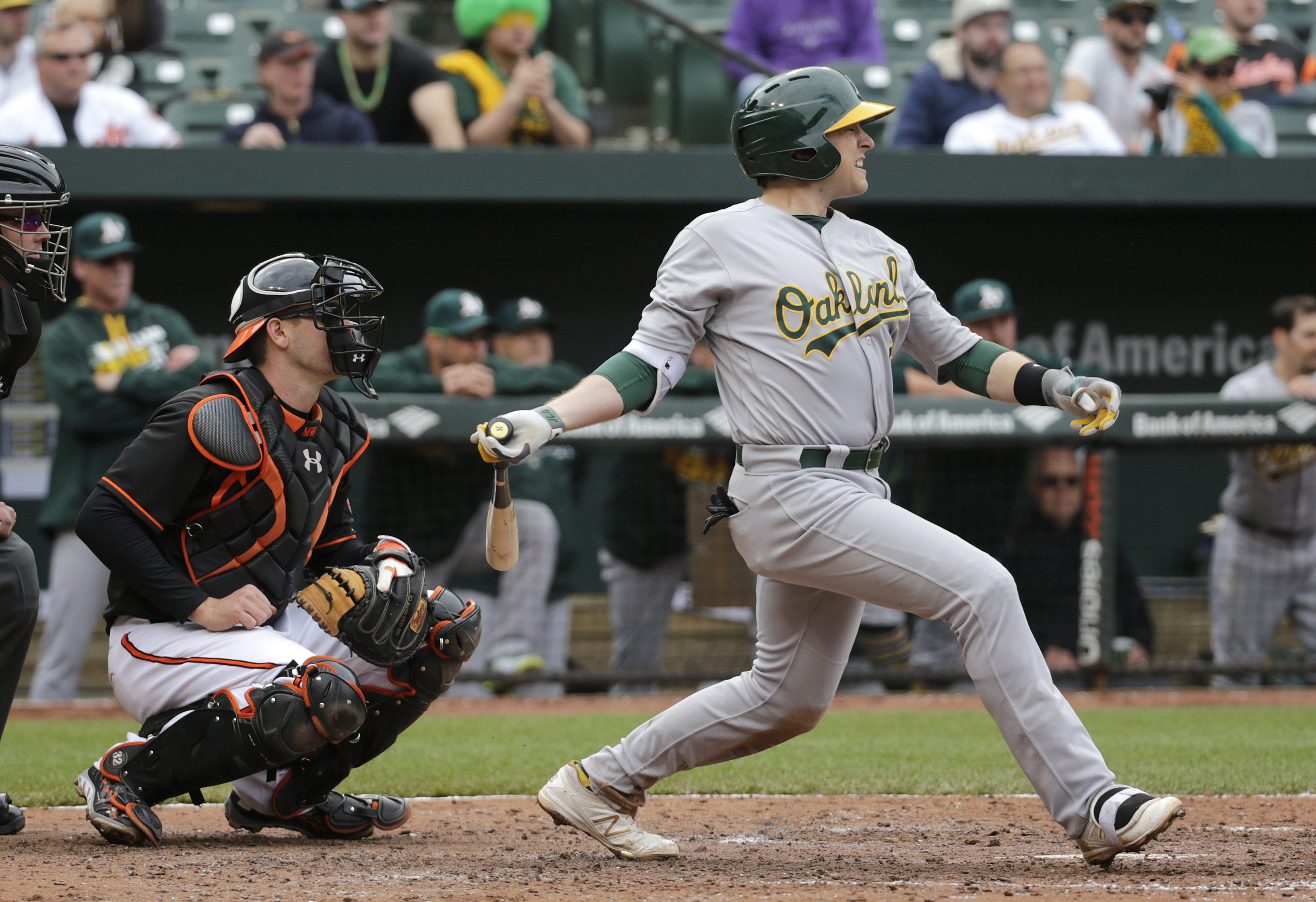 Oakland Athletics' Jed Lowrie singles in front of Baltimore Orioles catcher Matt Wieters in the sixth inning of the first baseball game of a doubleheader in Baltimore, Saturday, May 7, 2016. Yonder Alonso and Marcus Semien scored on the play. (AP Photo/Pa