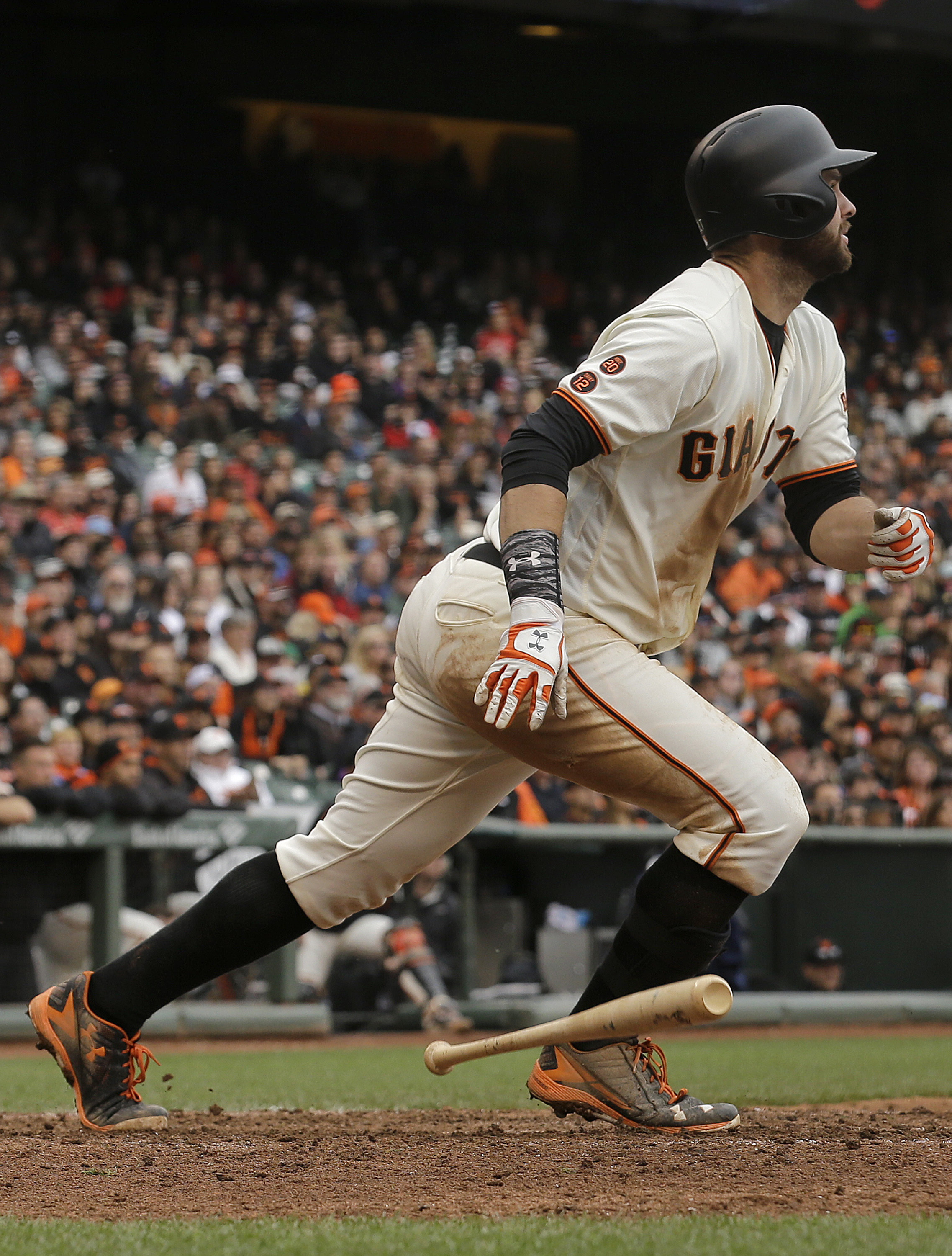 San Francisco Giants' Brandon Belt hits a triple against the Colorado Rockies during the tenth inning of a baseball game in San Francisco, Saturday, May 7, 2016. (AP Photo/Jeff Chiu)