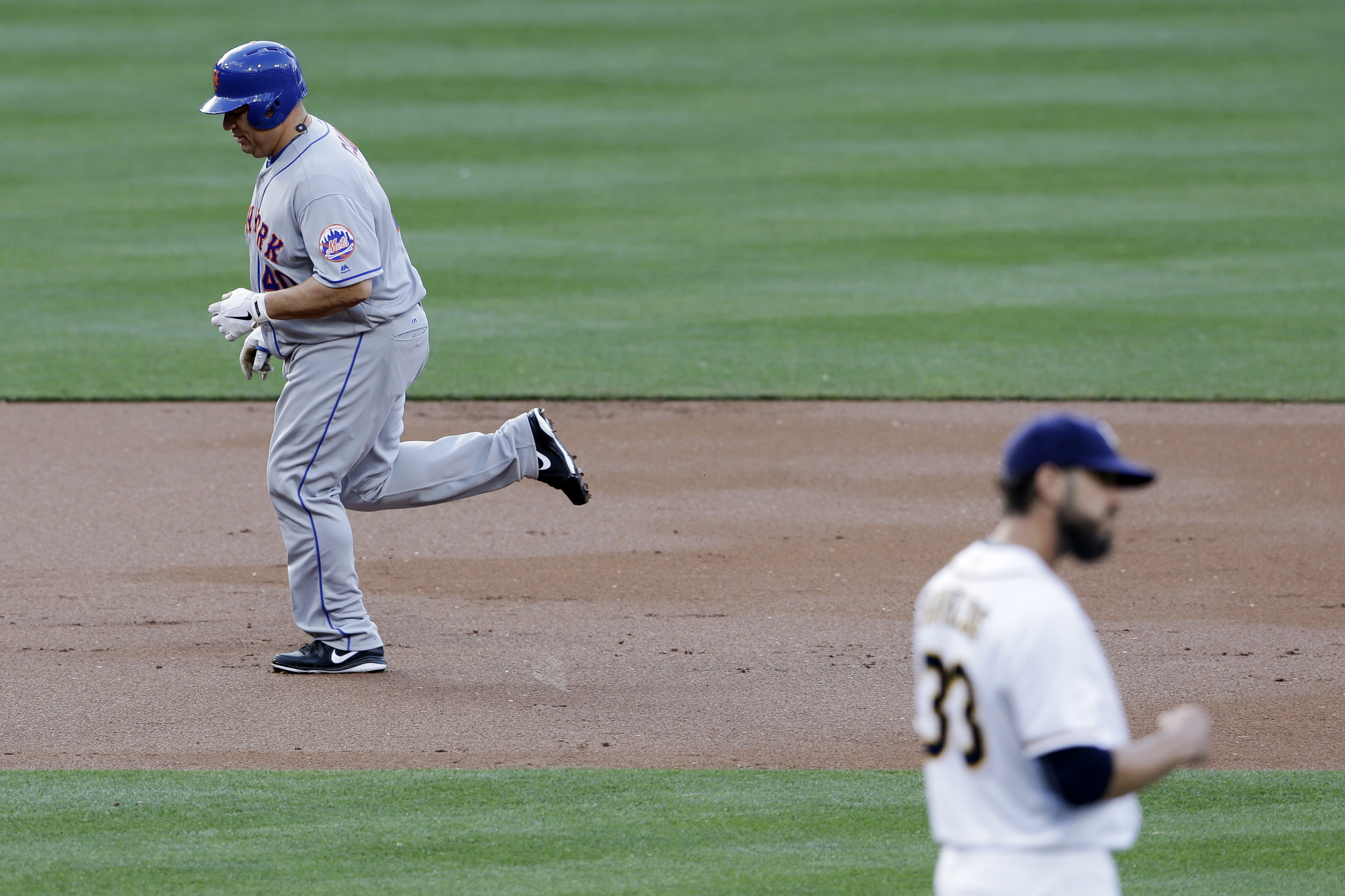 New York Mets' Bartolo Colon, left, rounds the bases after hitting a two-run home run off San Diego Padres starting pitcher James Shields, right, during the second inning of a baseball game Saturday, May 7, 2016, in San Diego. (AP Photo/Gregory Bull)