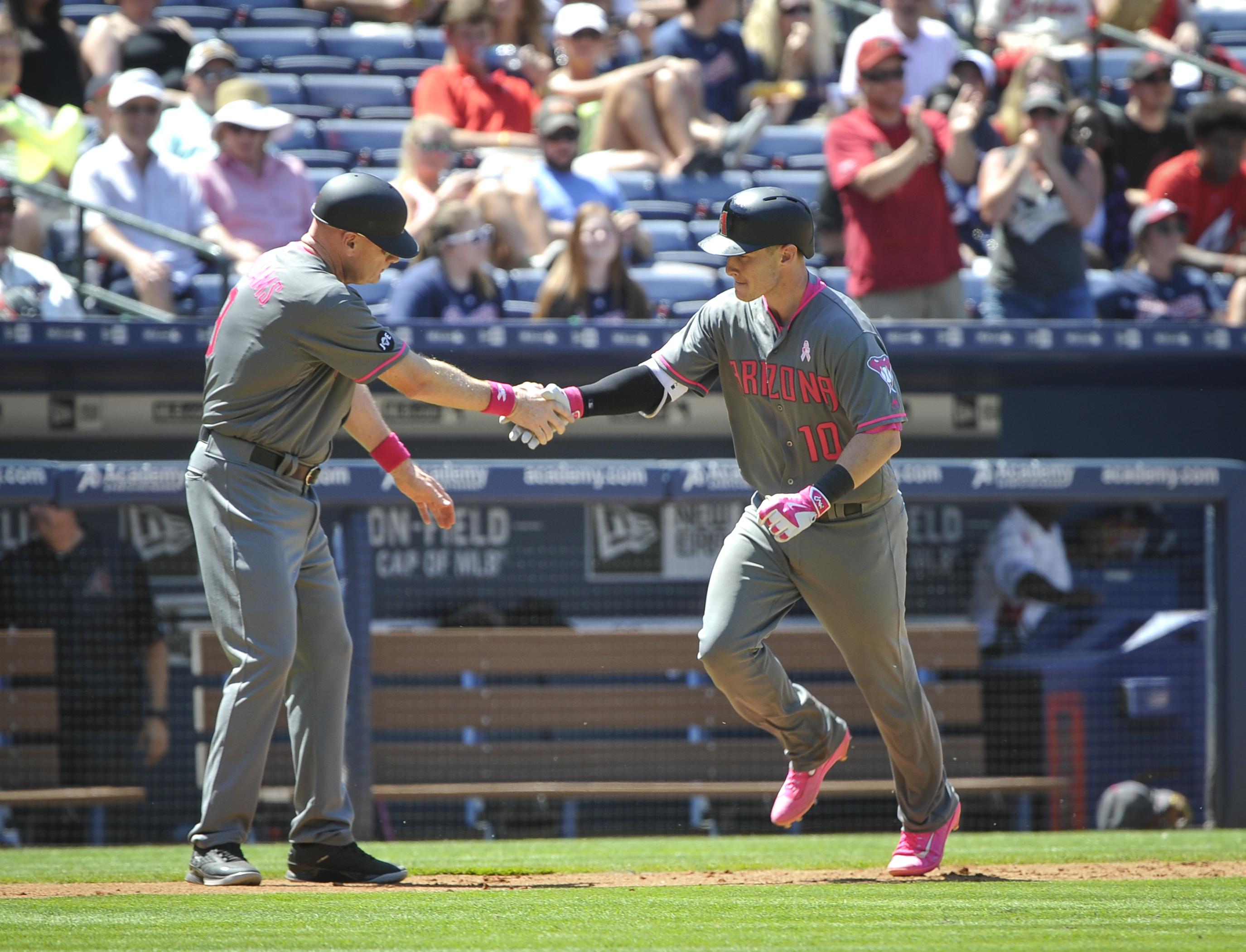 Arizona Diamondbacks' Chris Herrmann (10) rounds third base as third base coach Matt Williams congratulates him on his home run during the seventh inning of a baseball game against the Atlanta Braves, Sunday, May 8, 2016, in Atlanta. (AP Photo/John Amis)