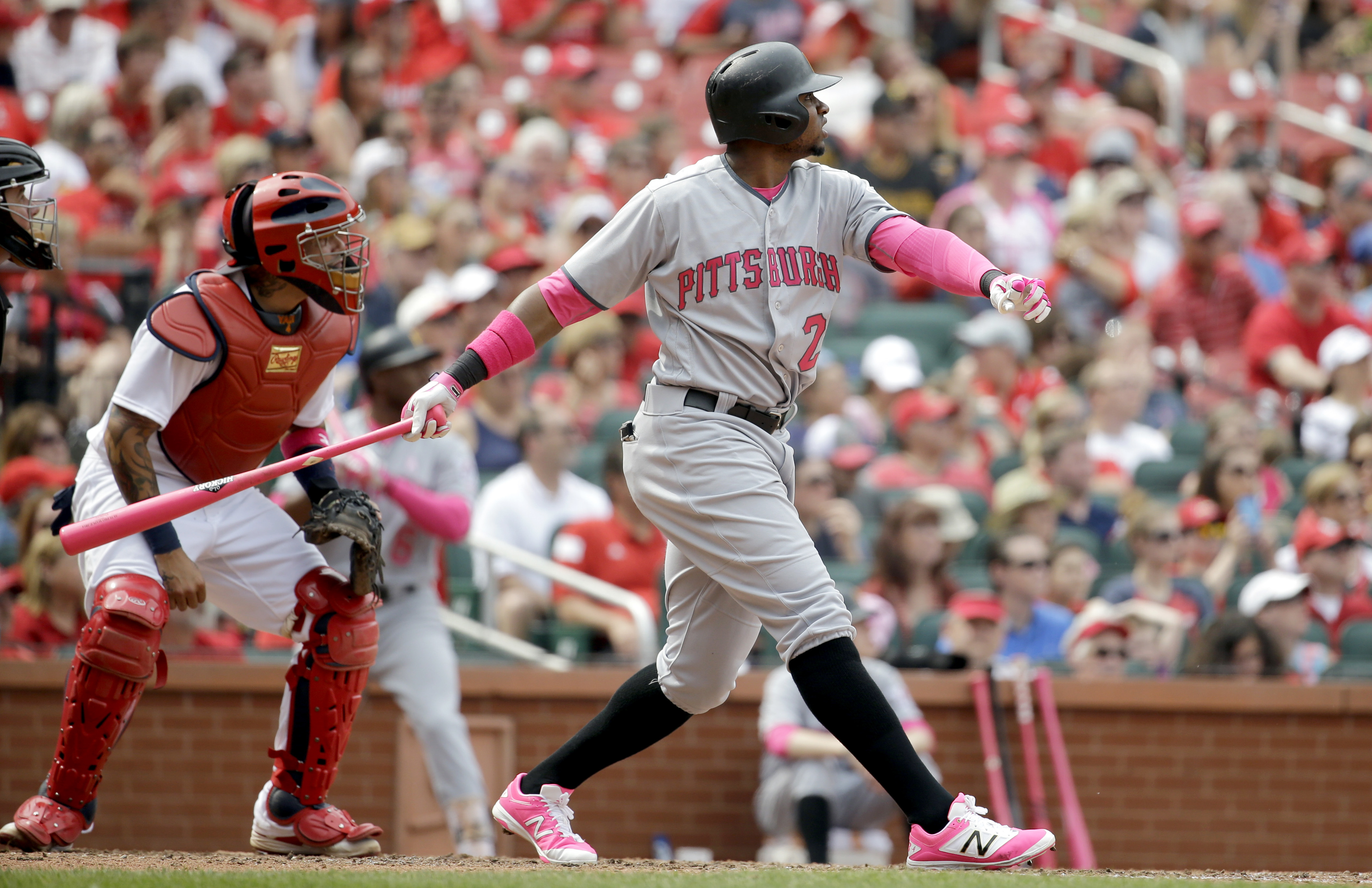 Pittsburgh Pirates' Gregory Polanco, right, and St. Louis Cardinals catcher Yadier Molina watch Polanco's three-run home run during the seventh inning of a baseball game Sunday, May 8, 2016, in St. Louis. (AP Photo/Jeff Roberson)