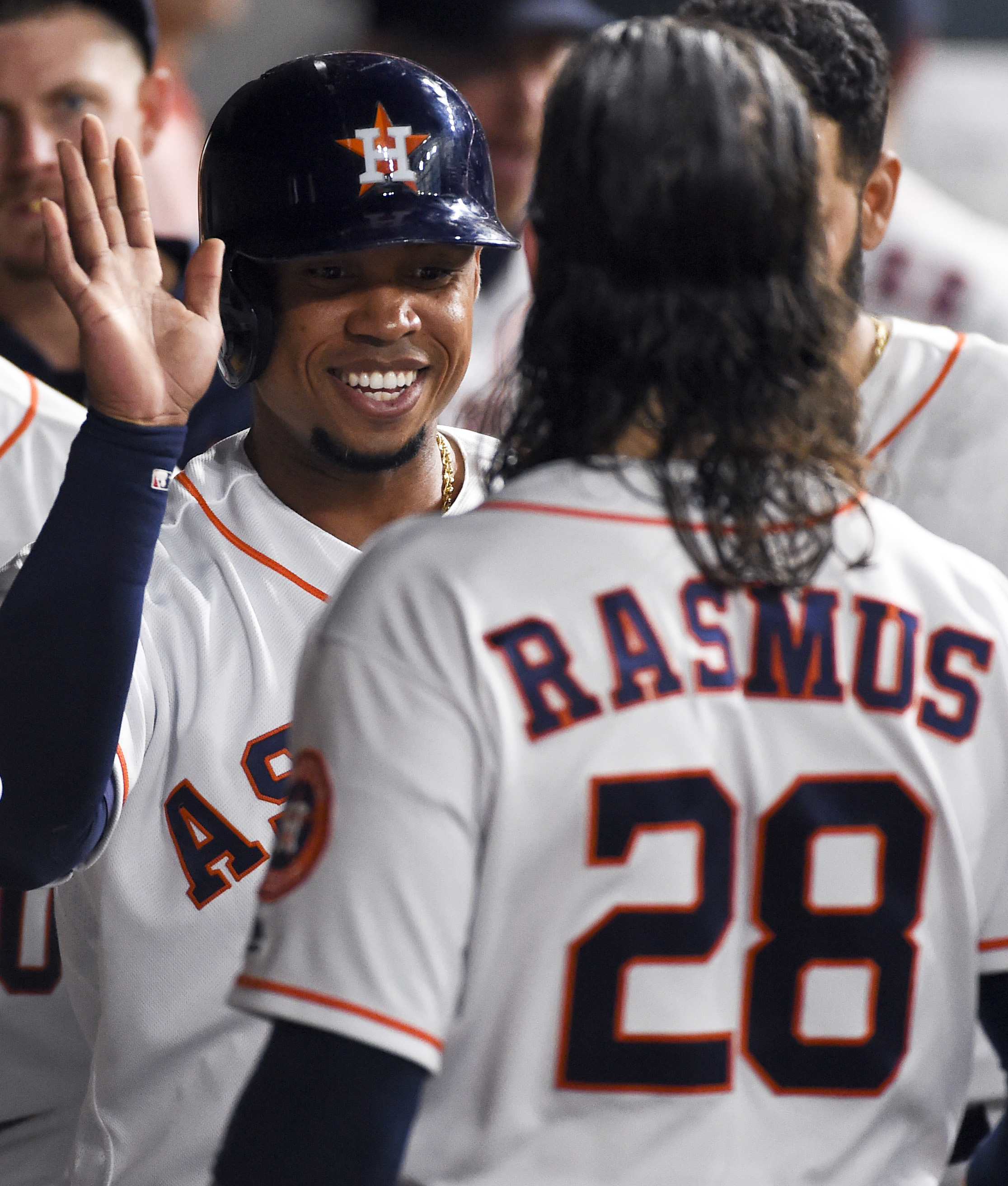 Houston Astros Luis Valbuena, left, celebrates scoring a run on Jose Altus's two-run double with Colby Rasmus (28) in the third inning of a baseball game against the Cleveland Indians, Monday, May 9, 2016, in Houston. (AP Photo/Eric Christian Smith)