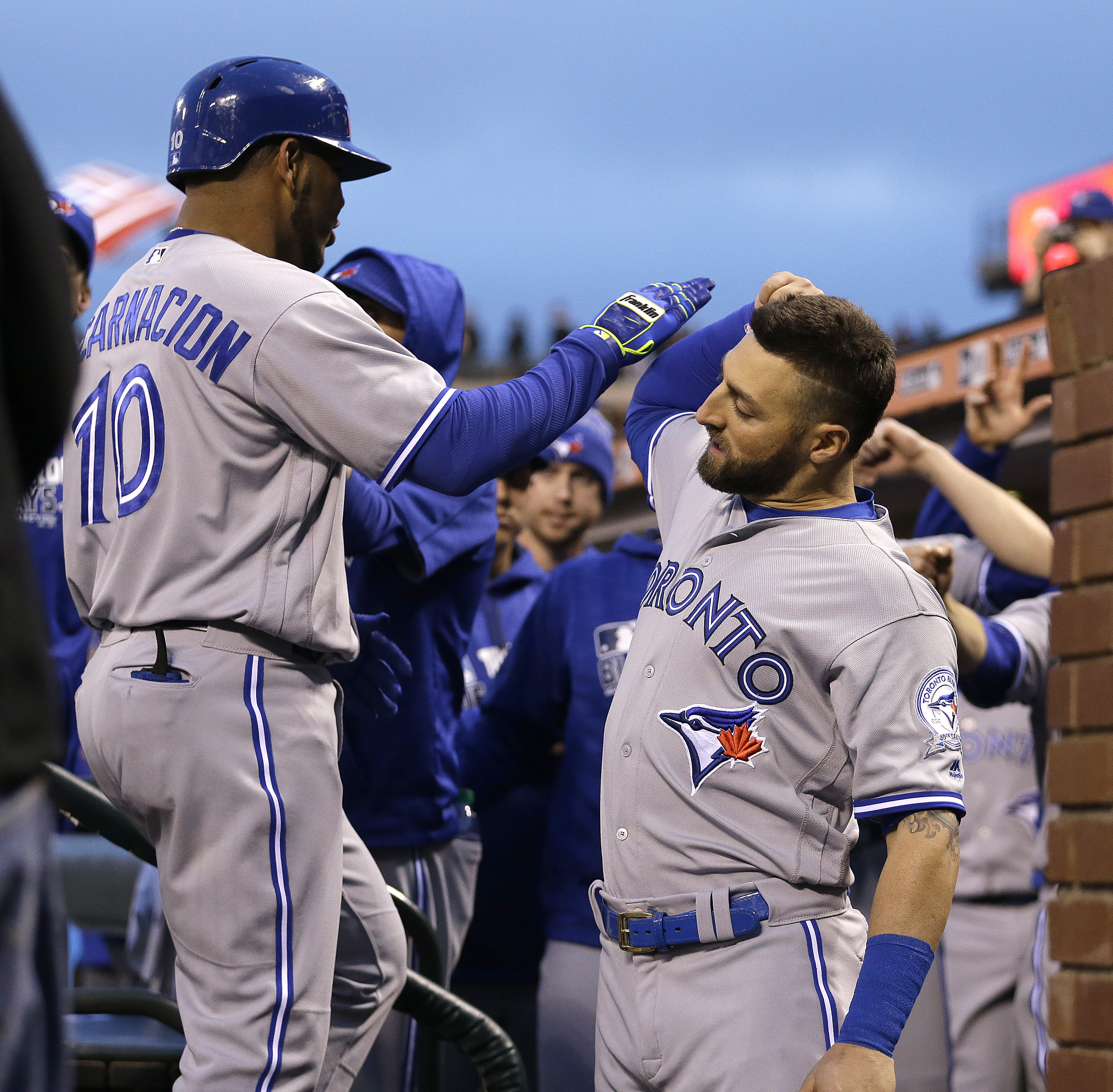 Toronto Blue Jays' Edwin Encarnacion, left, celebrates with Kevin Pillar (11) after hitting a two-run home run off San Francisco Giants' Jake Peavy in the third inning of a baseball game Monday, May 9, 2016, in San Francisco. (AP Photo/Ben Margot)