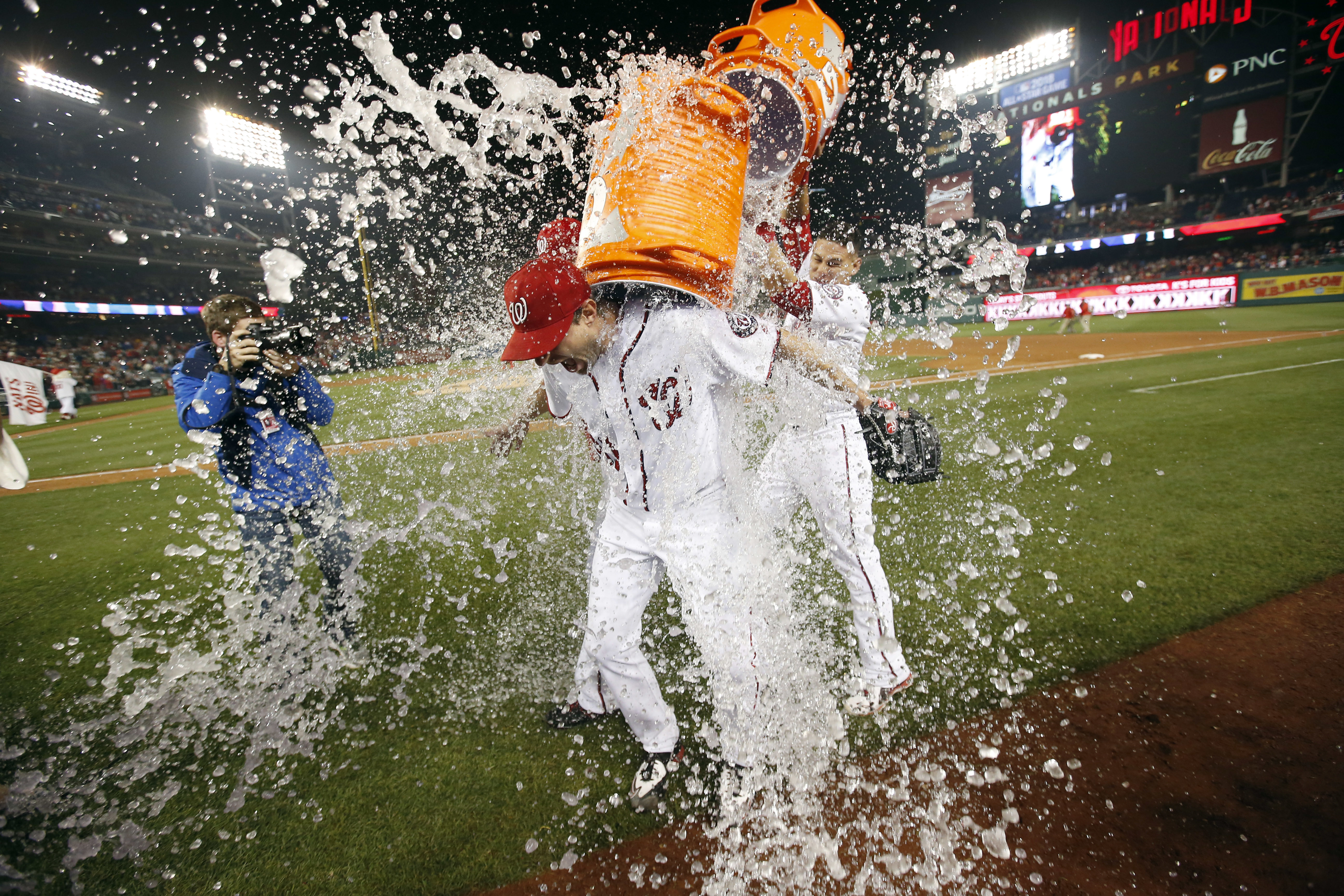 Washington Nationals starting pitcher Max Scherzer is doused after the team's baseball game against the Detroit Tigers at Nationals Park, Wednesday, May 11, 2016, in Washington. Scherzer struck out 20 batters, tying the major league nine-inning record. Th
