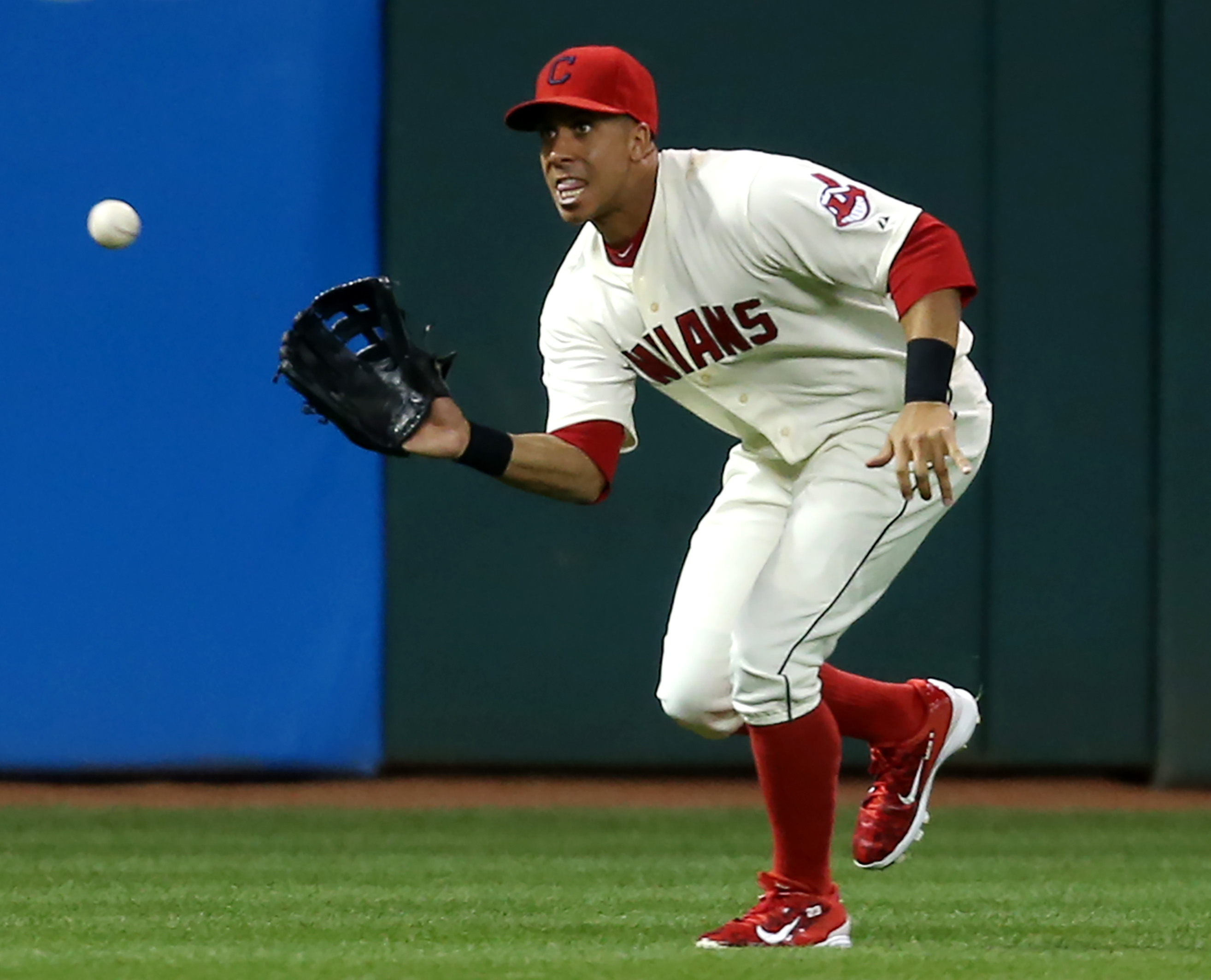 FILE - In this Sept. 19, 2015 file photo, Cleveland Indians outfielder Michael Brantley makes a running catch to put out Chicago White Sox's Micah Johnson during the third inning of a baseball game, in Cleveland. The Indians have placed Brantley on the 15