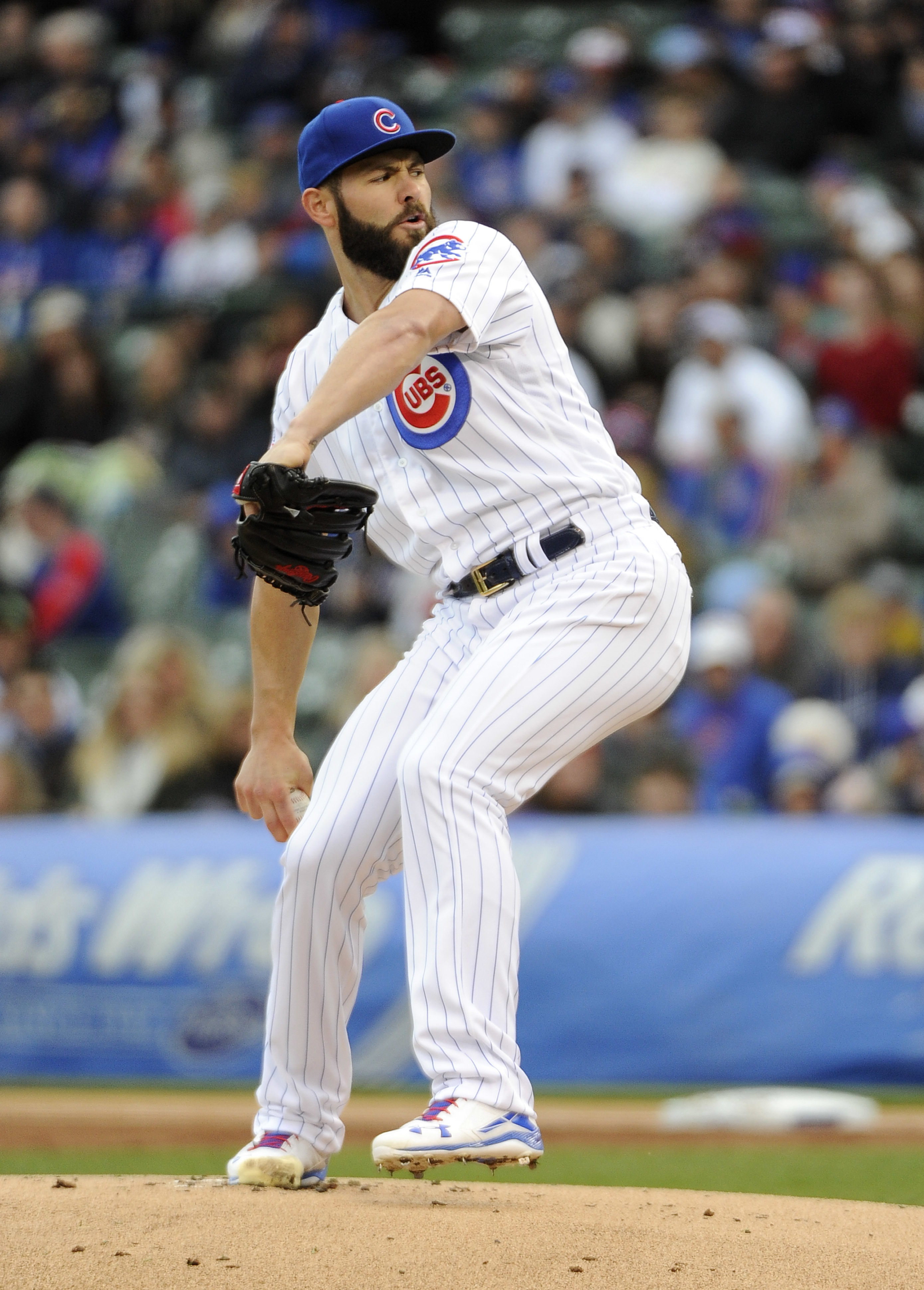 Chicago Cubs starting pitcher Jake Arrieta (49) throws against the Pittsburgh Pirates during the first inning of a baseball game, Saturday, May 14, 2016, in Chicago. (AP Photo/David Banks)