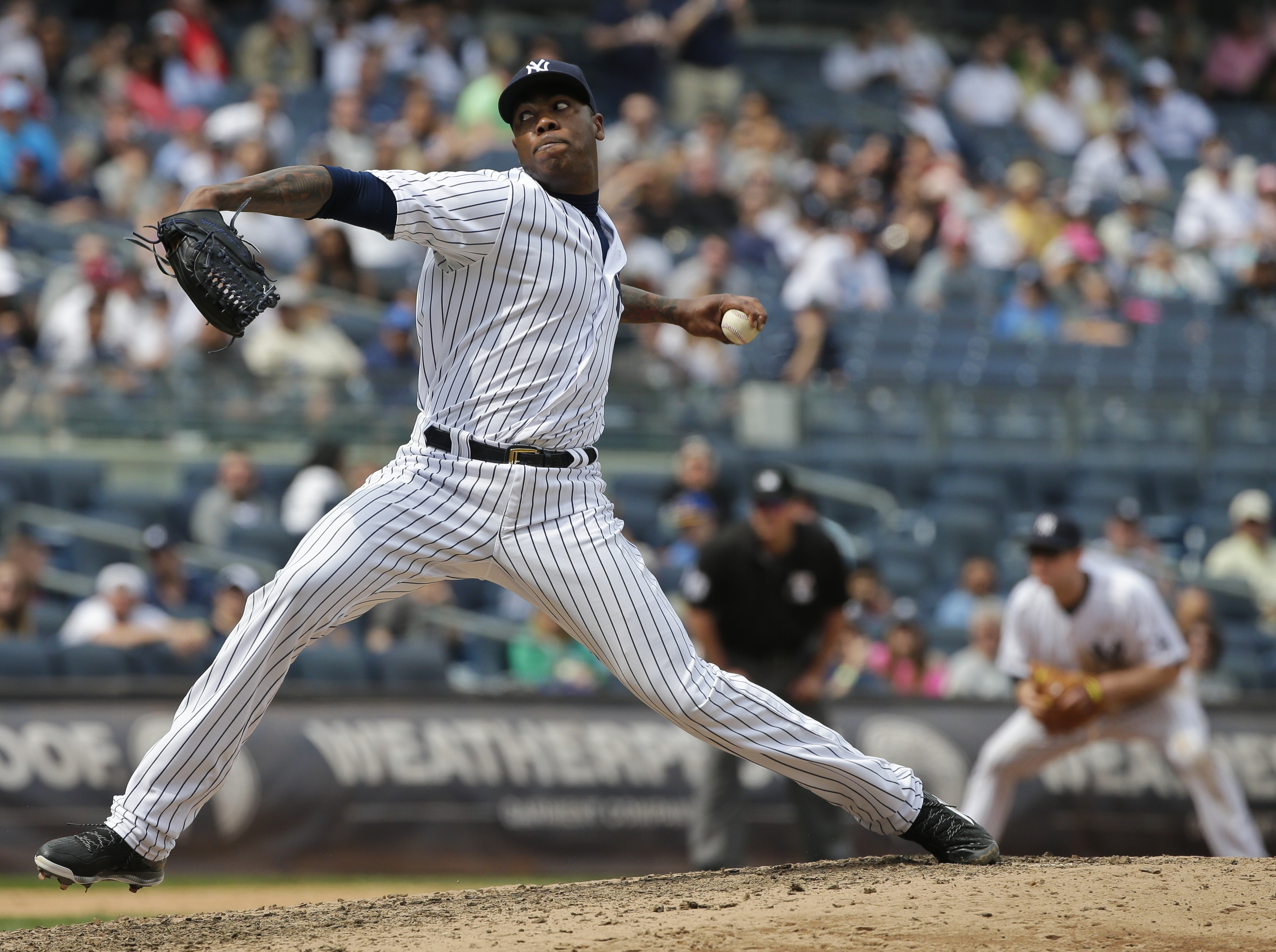 New York Yankees relief pitcher Aroldis Chapman (54) delivers a pitch during the ninth inning of a baseball game Saturday, May 14, 2016, in New York. Chapman picked up his second save as the Yankees won 2-1. (AP Photo/Frank Franklin II)