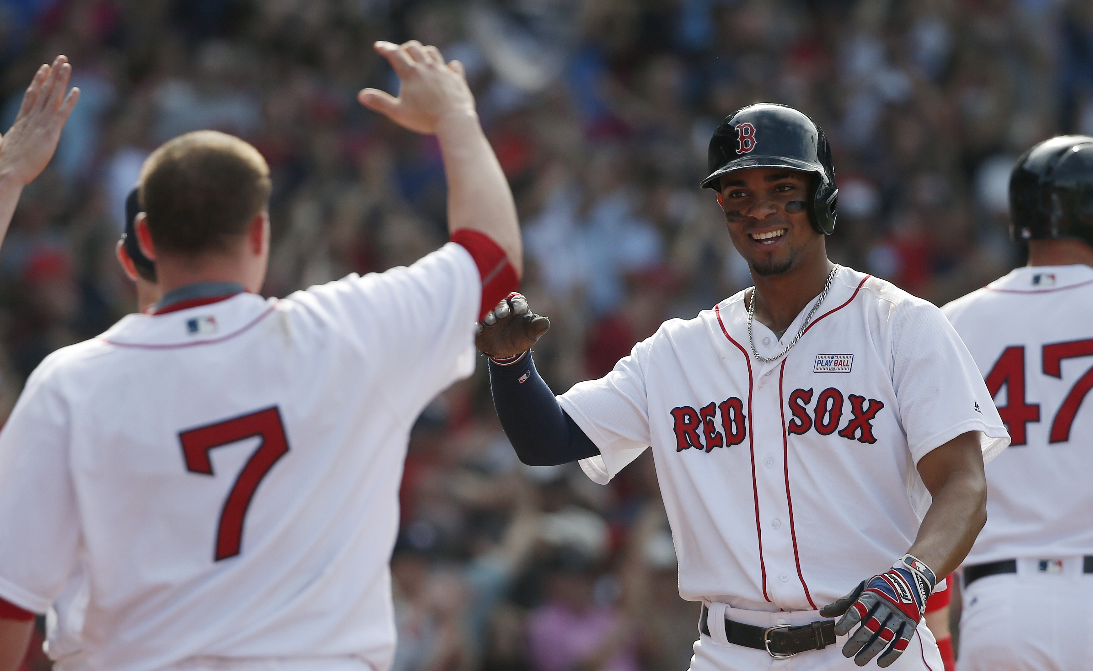 Boston Red Sox's Xander Bogaerts, right, celebrates after scoring the tying run on a triple by David Ortiz during the ninth inning of a baseball game against the Houston Astros in Boston, Saturday, May 14, 2016. (AP Photo/Michael Dwyer)