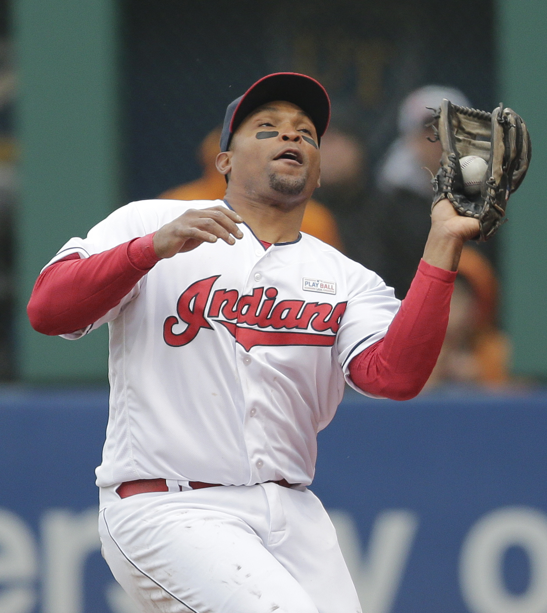 Cleveland Indians' Marlon Byrd catches a foul sacrifice fly hit by Minnesota Twins' Eduardo Nunez in the seventh inning of a baseball game, Saturday, May 14, 2016, in Cleveland. Danny Santana scored on the play. (AP Photo/Tony Dejak)