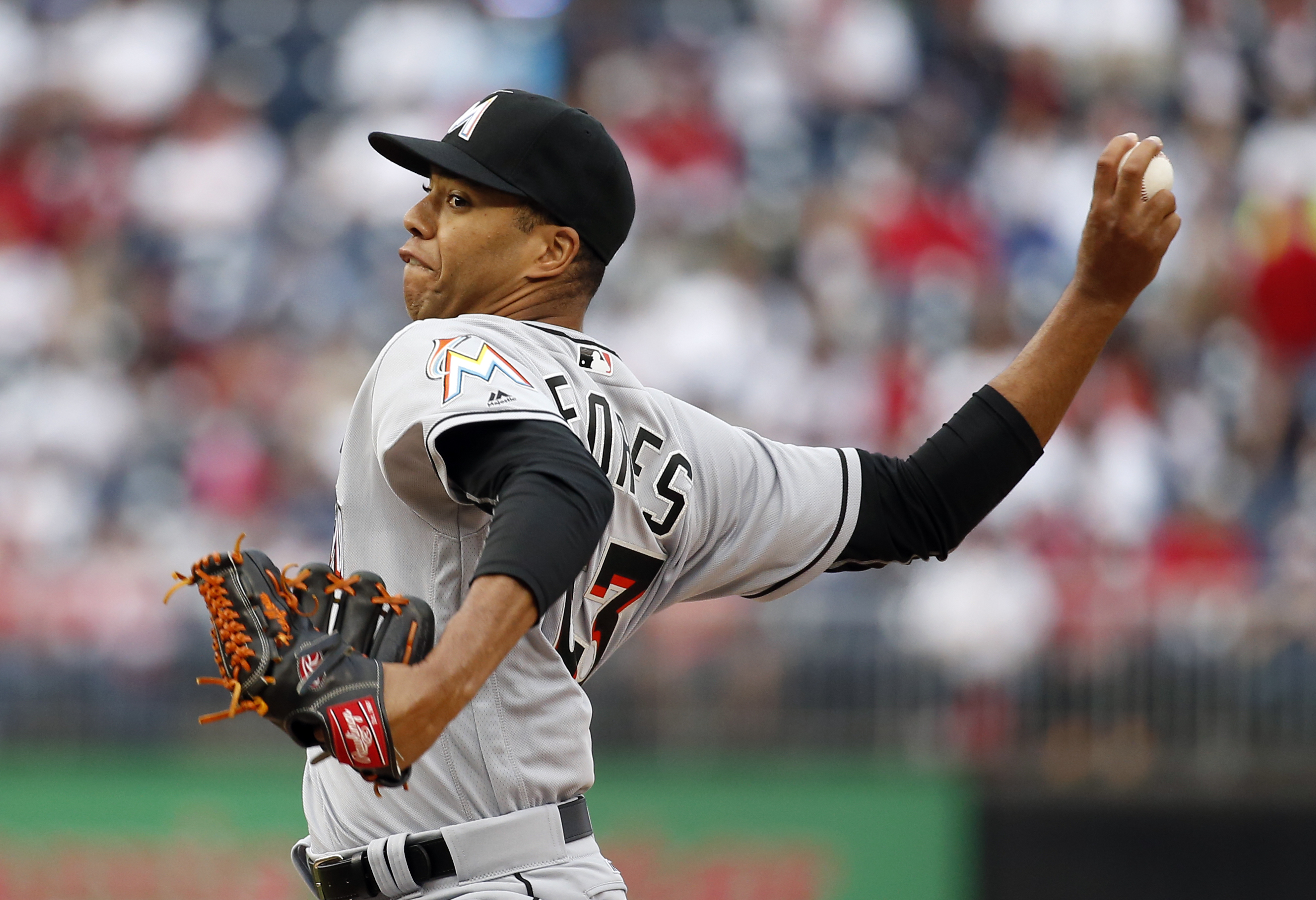 Miami Marlins starting pitcher Kendry Flores throws during the first inning of the second baseball game of a split doubleheader against the Washington Nationals at Nationals Park, Saturday, May 14, 2016, in Washington. (AP Photo/Alex Brandon)