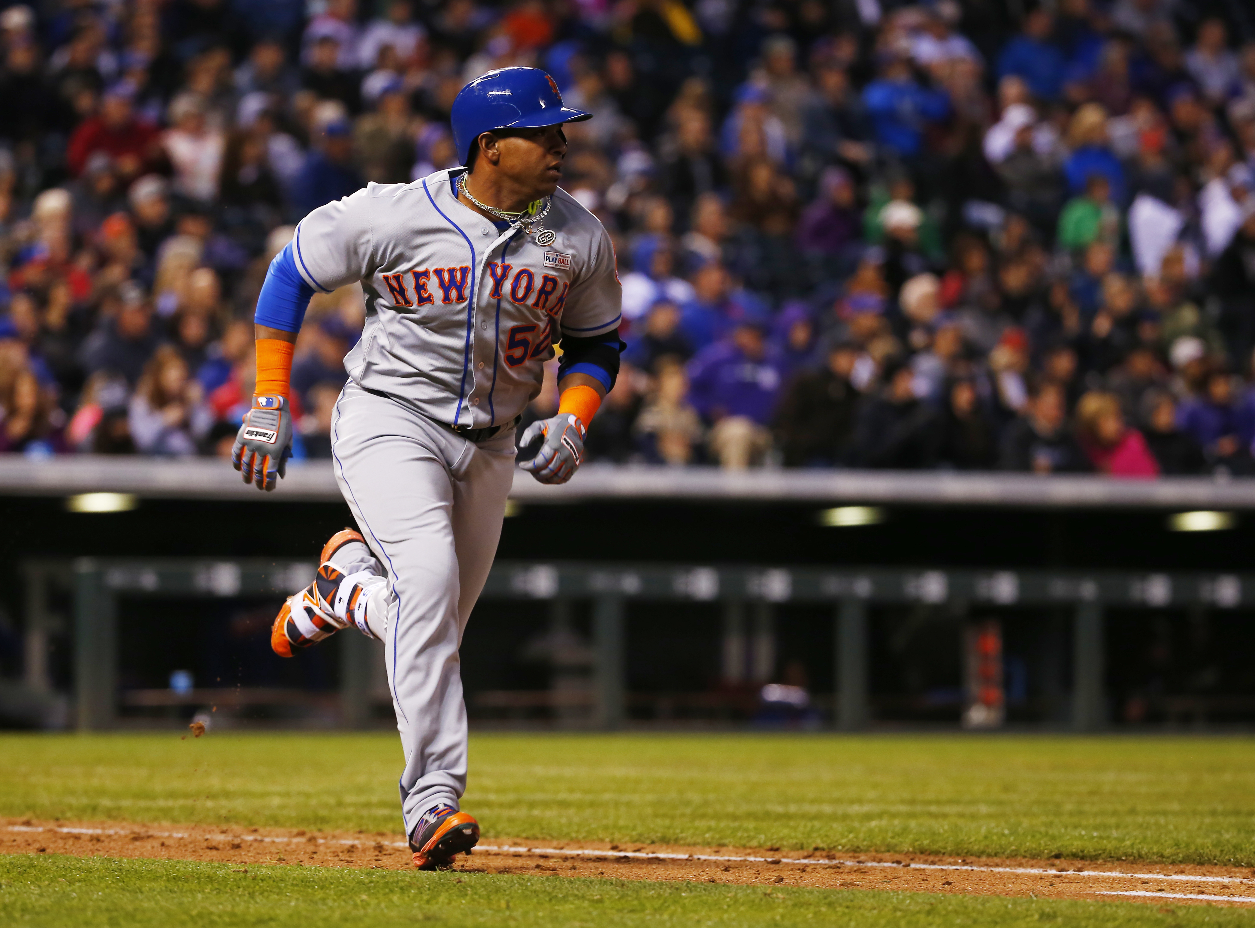 New York Mets' Yoenis Cespedes runs to first after hitting a triple off Colorado Rockies starting pitcher Eddie Butler during the sixth inning of a baseball game Saturday, May 14, 2016, in Denver. (AP Photo/Jack Dempsey)