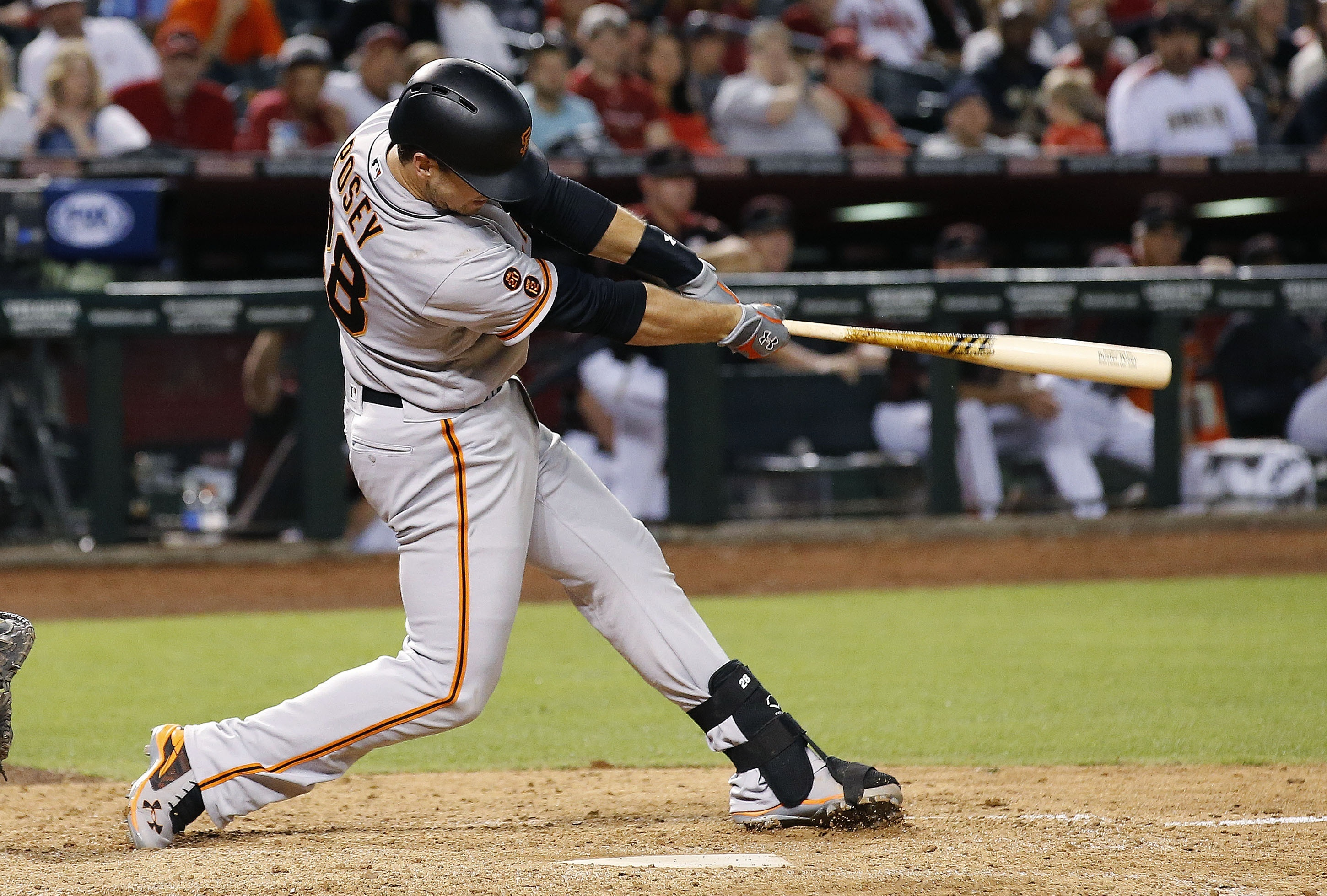 San Francisco Giants' Buster Posey connects for a two-run double against the Arizona Diamondbacks during the ninth inning of a baseball game Saturday, May 14, 2016, in Phoenix. (AP Photo/Ross D. Franklin)