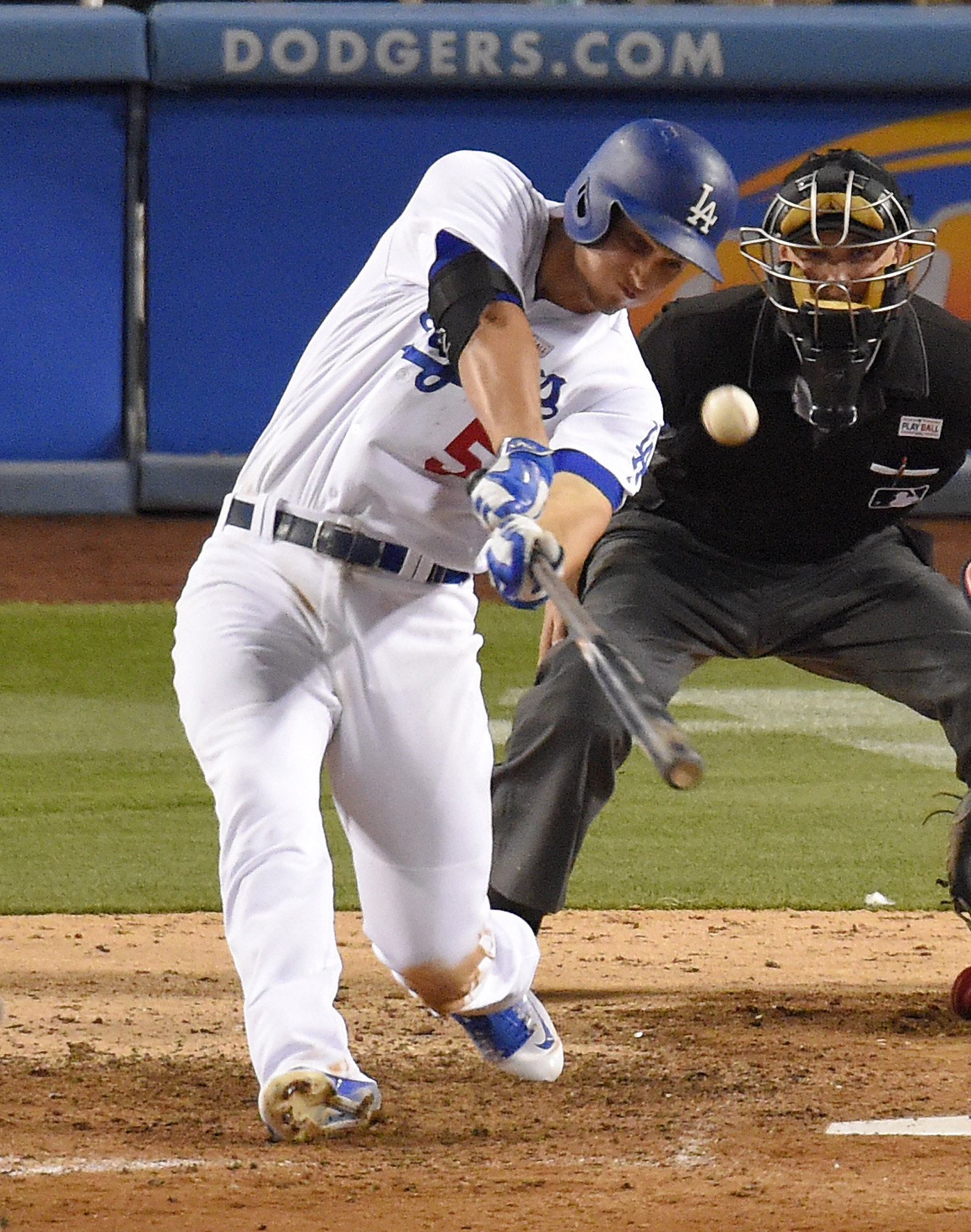 Los Angeles Dodgers' Corey Seager hits a solo home run as home plate umpire Adam Hamari watches during the seventh inning of a baseball game against the St. Louis Cardinals, Saturday, May 14, 2016, in Los Angeles. (AP Photo/Mark J. Terrill)