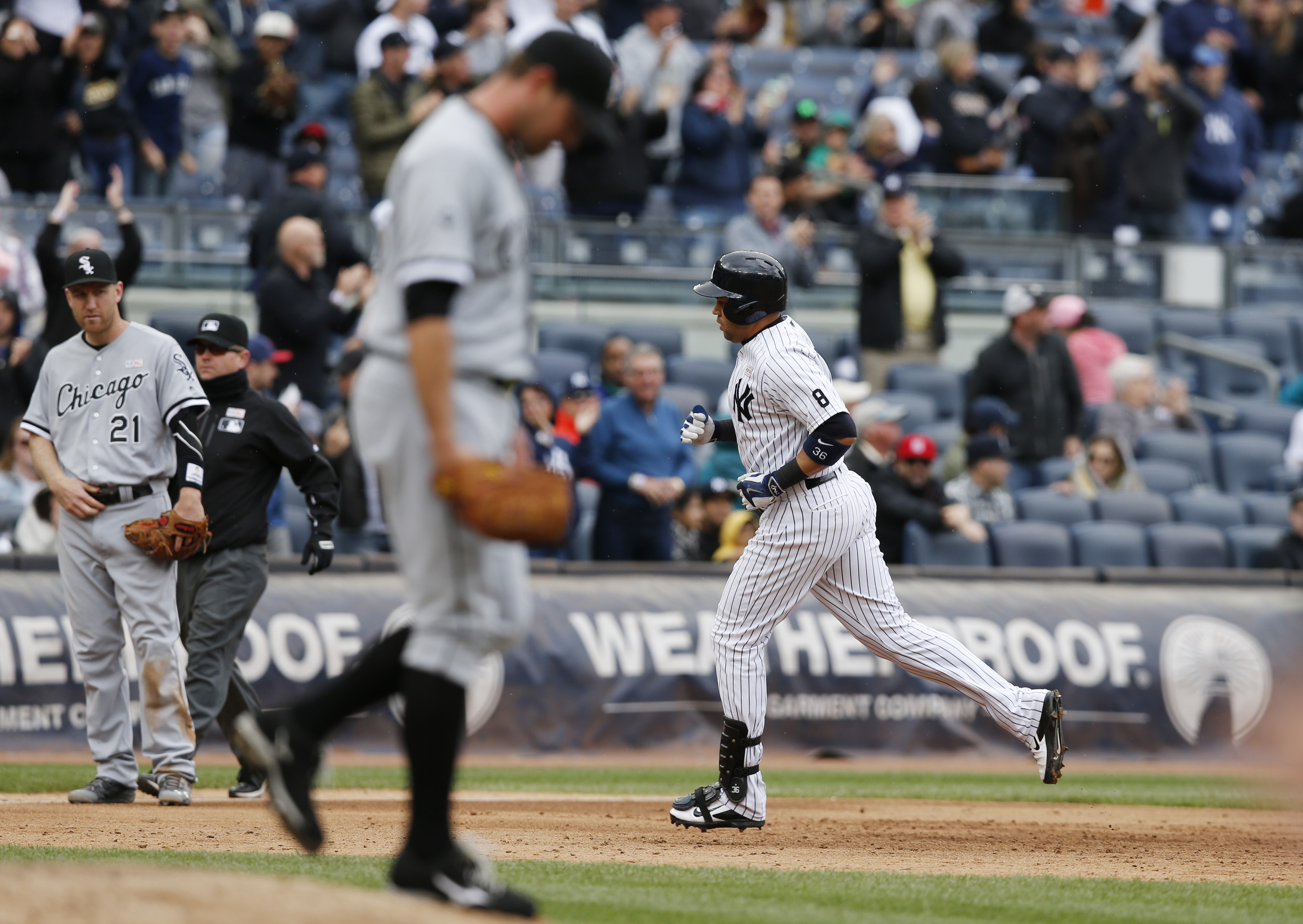 New York Yankees designated hitter Carlos Beltran, right, runs the bases after hitting a two-run, home run off Chicago White Sox relief pitcher Zach Duke, center, during the sixth inning of a baseball game in New York, Sunday, May 15, 2016. Chicago White