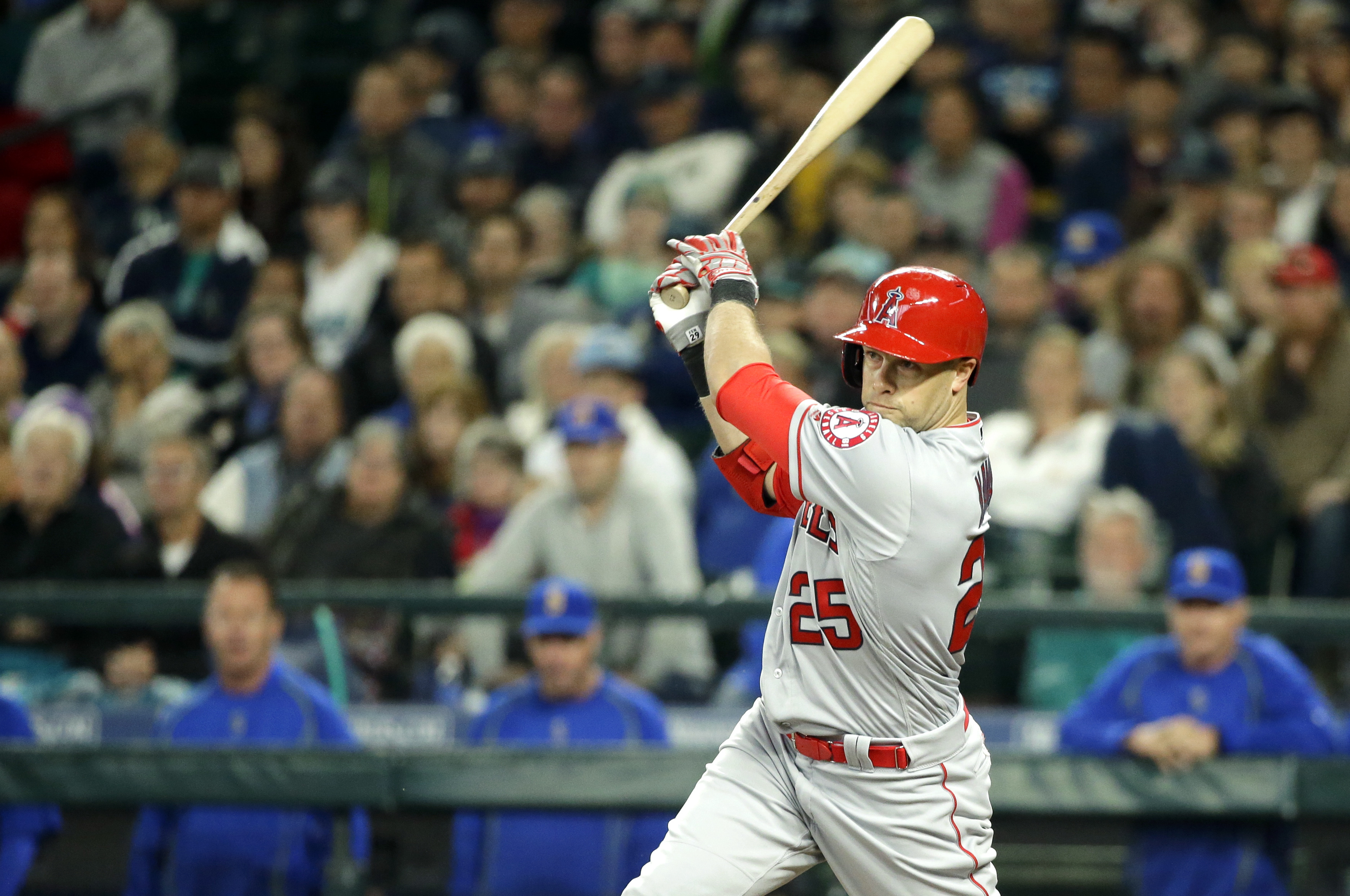 Los Angeles Angels' Daniel Nava hits a two-run single in the eighth inning of a baseball game against the Seattle Mariners, Sunday, May 15, 2016, in Seattle. (AP Photo/Ted S. Warren)